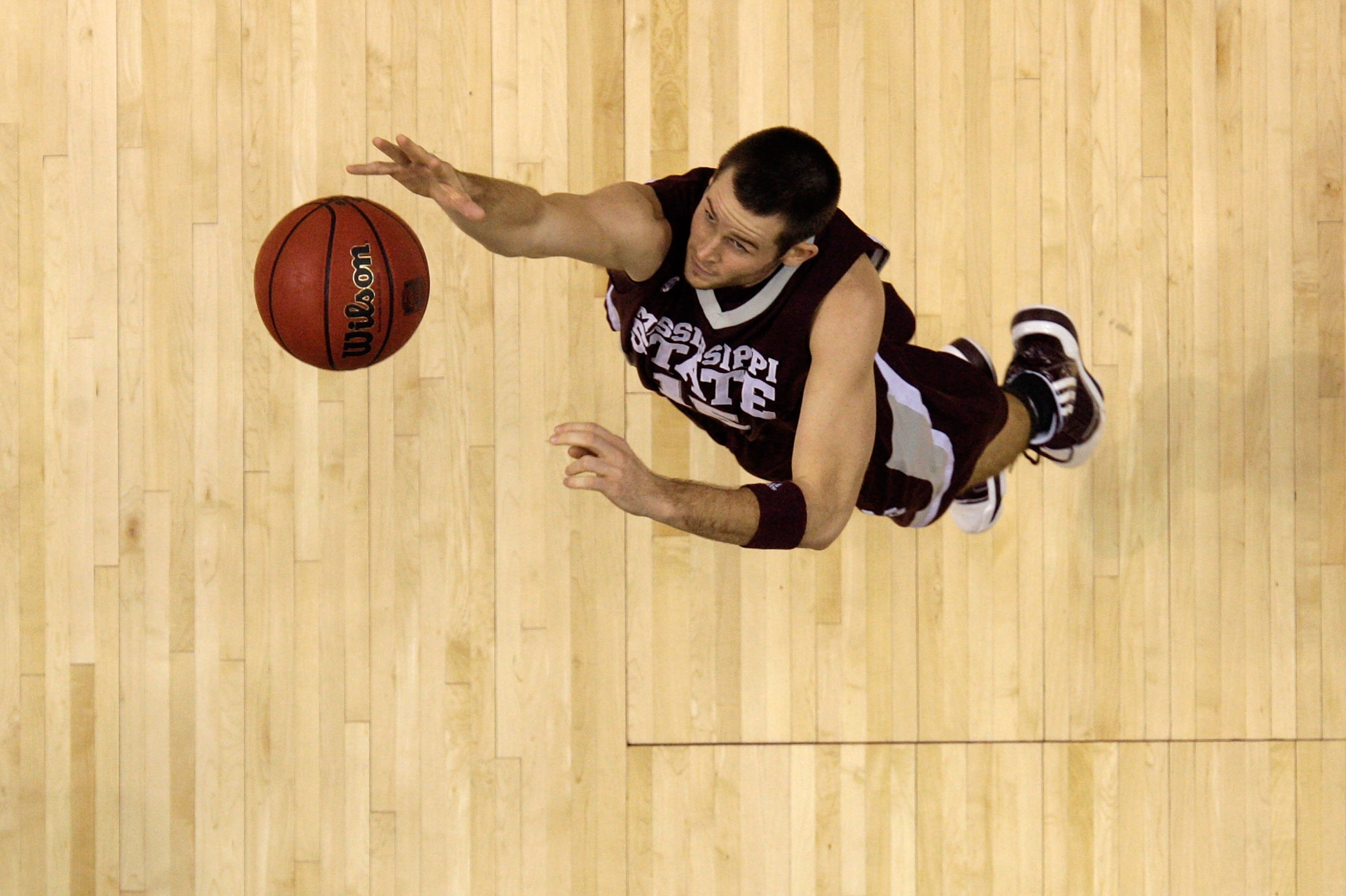 NASHVILLE, TN - MARCH 14:  Riley Benock #15 of the Mississippi State Bulldogs reaches for a rebound against the Kentucky Wildcats during the final of the SEC Men's Basketball Tournament at the Bridgestone Arena on March 14, 2010 in Nashville, Tennessee. K