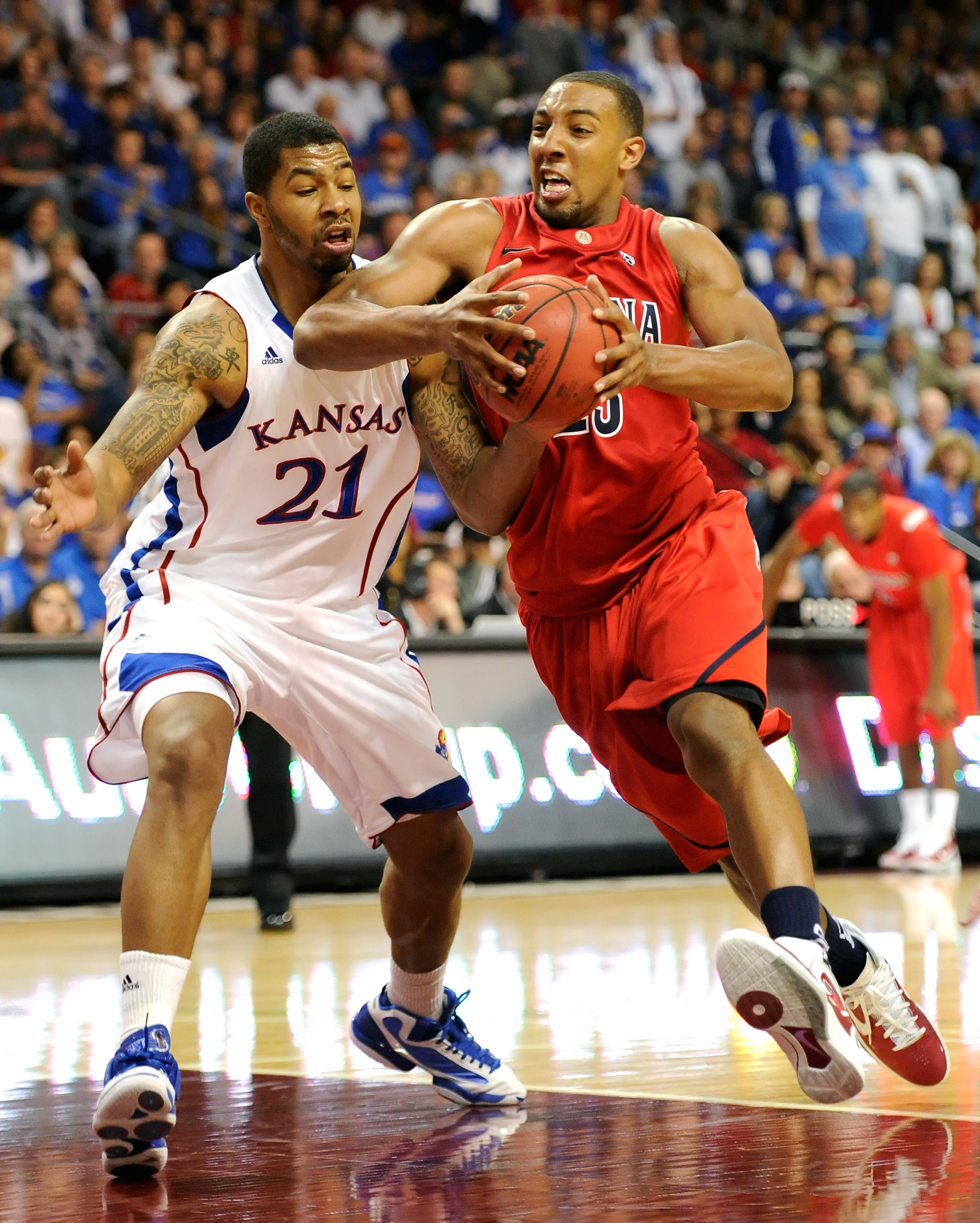 LAS VEGAS - NOVEMBER 27:  Markieff Morris #21 of the Kansas Jayhawks fouls Derrick Williams #23 of the Arizona Wildcats during the championship game of the Las Vegas Invitational at The Orleans Arena November 27, 2010 in Las Vegas, Nevada. Kansas won 87-7