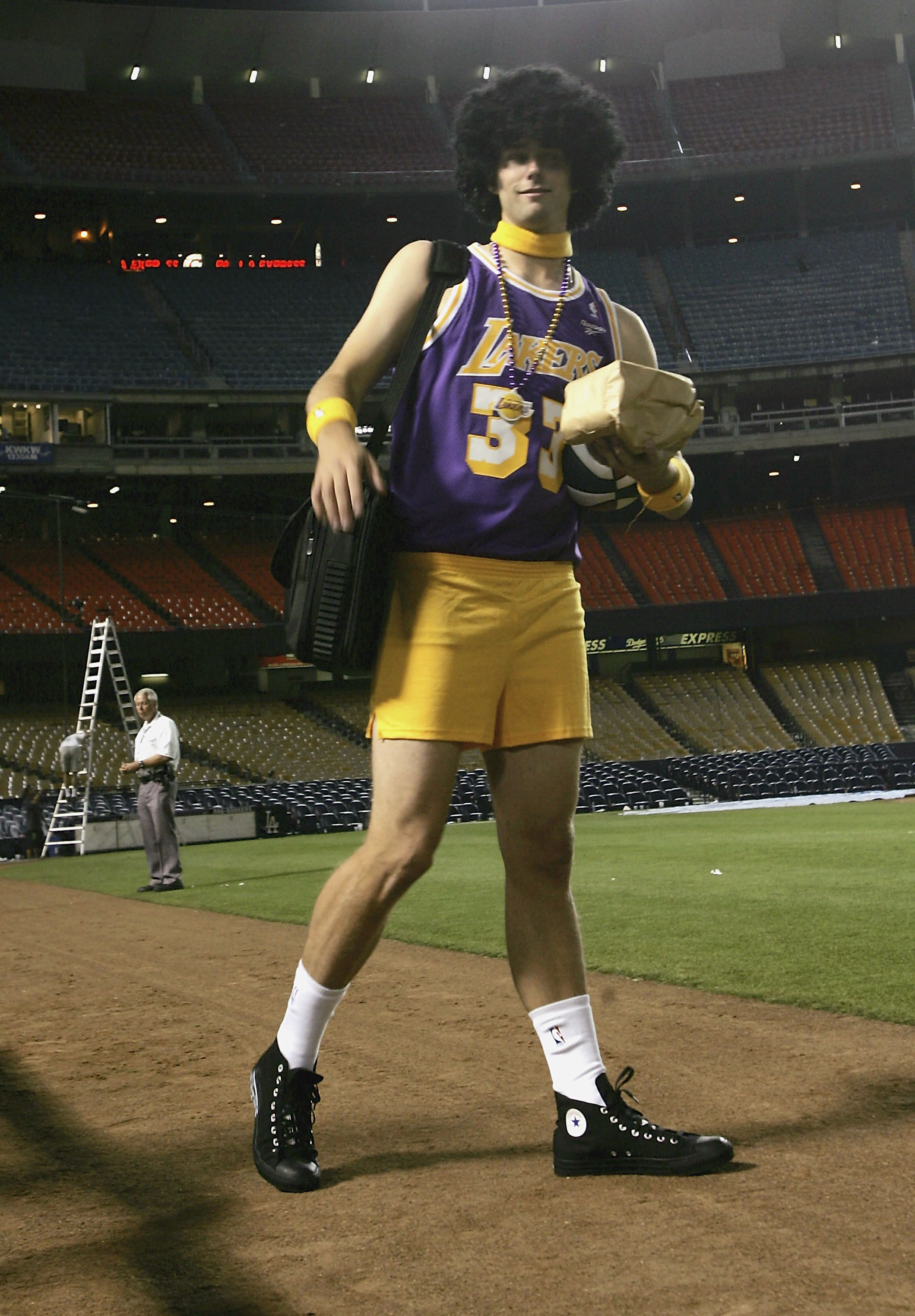 LOS ANGELES - SEPTEMBER 29:   Starting pitcher Dustin Nippert #57 of the Arizona Diamondbacks wears Laker clothes in traditional rookie hazing as he leaves the stadium after the game with the Los Angeles Dodgers on September 29, 2005 at Dodger Stadium in