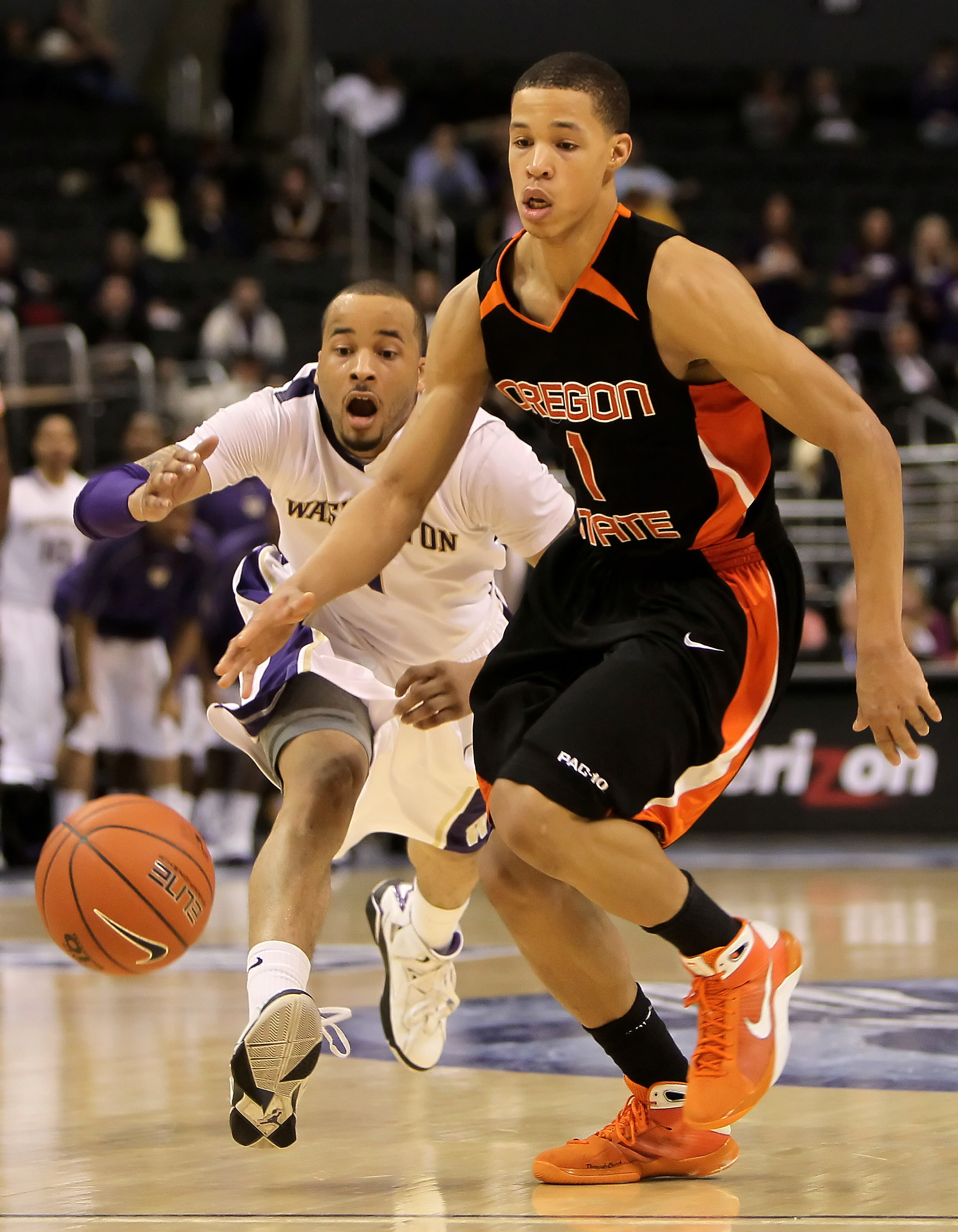 LOS ANGELES, CA - MARCH 11:  Venoy Overton #1 of the Washington Huskies pursues Jared Cunningham #1 of the Oregon State Beavers for the ball in the second half during the Quarterfinals of the Pac-10 Basketball Tournament at Staples Center on March 11, 201