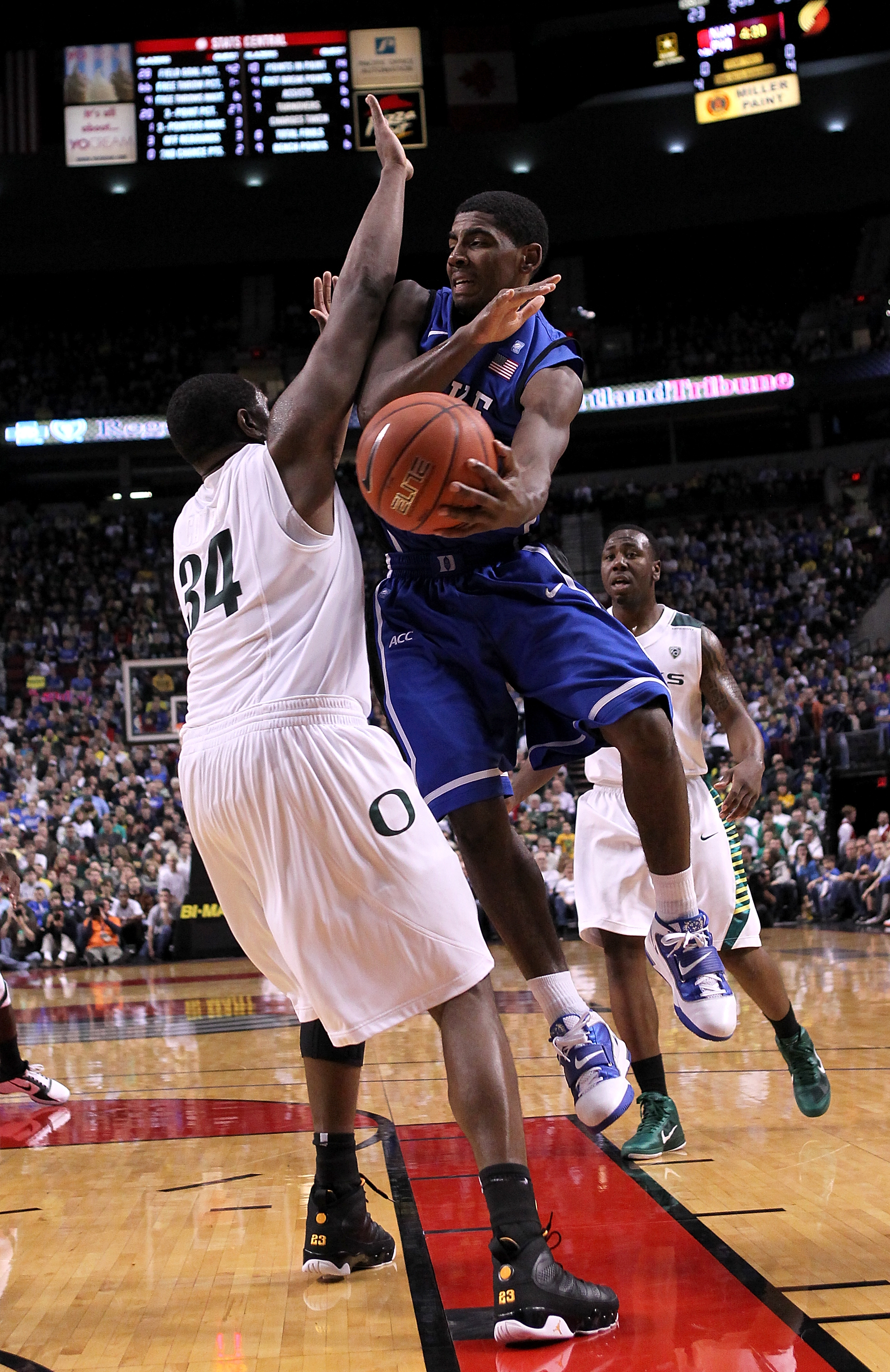 PORTLAND, OR - NOVEMBER 27:  Kyrie Irving #1 of the Duke Blue Devils looks to pass the ball against Joevan Catron #34 of the Oregon Ducks on November 27, 2010 at the Rose Garden in Portland, Oregon.  (Photo by Jonathan Ferrey/Getty Images)