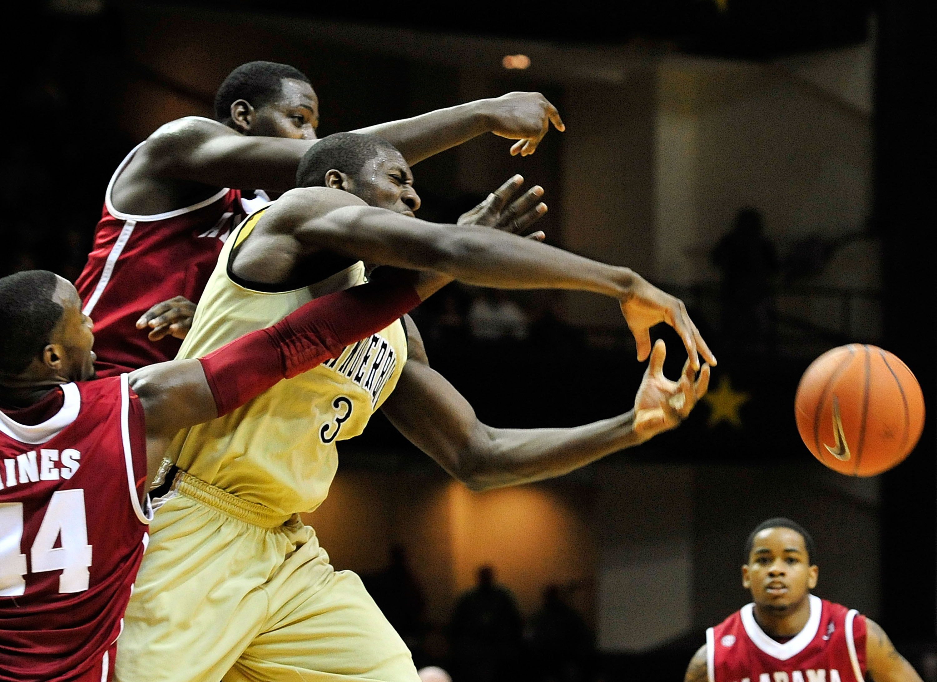 NASHVILLE, TN - FEBRUARY 10:  Festus Ezeli #3 of the Vanderbilt Commodores of battles for the ball with Chris Hines #44 and JaMychal Green #1 the Alabama Crimson Tide at Memorial Gym on February 10, 2011 in Nashville, Tennessee. Vanderbilt won 81-77. (Pho
