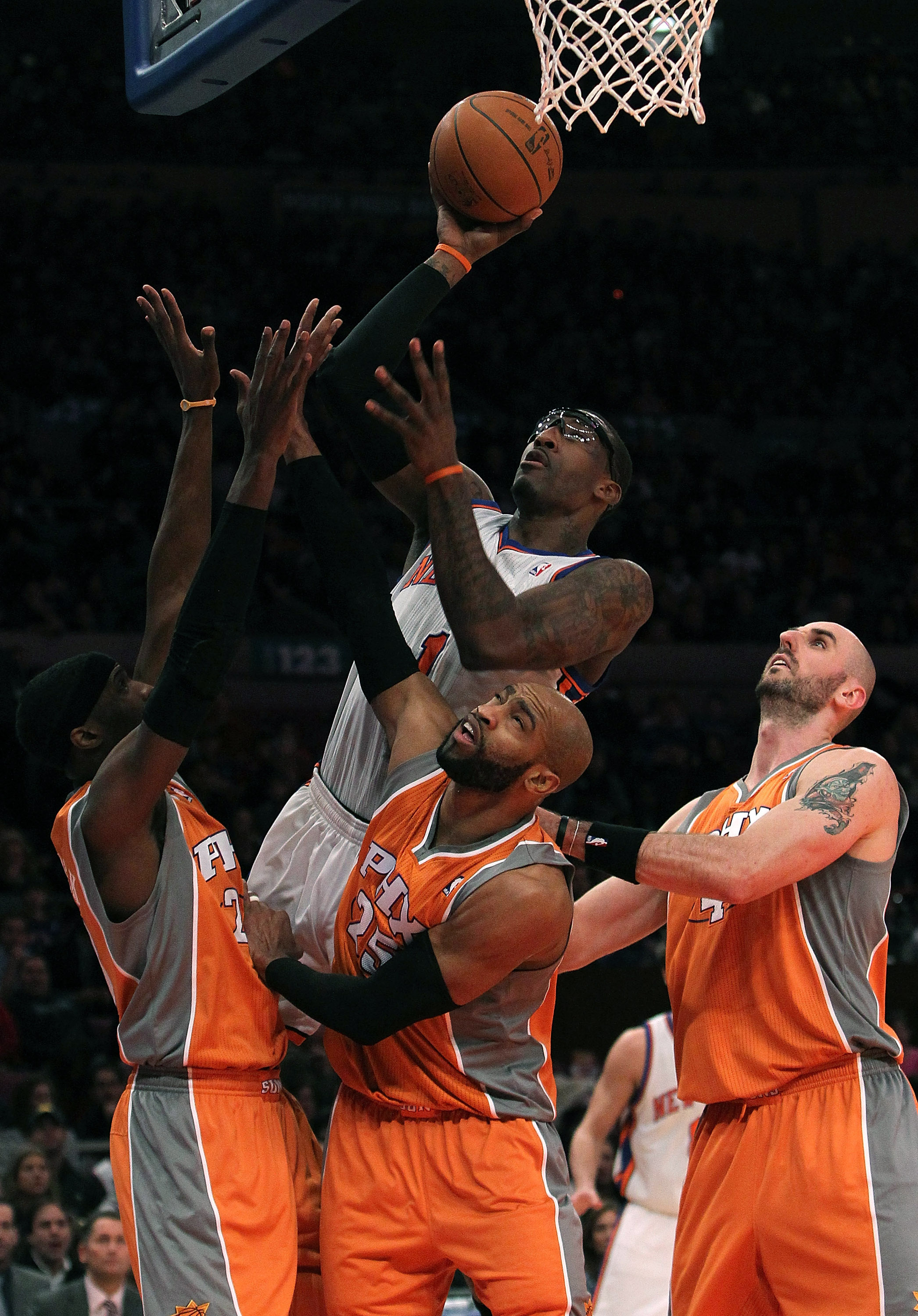 NEW YORK, NY - JANUARY 17:  Amar'e Stoudemire #1 of the New York Knicks shoots the ball against Hakim Warrick #21, Vince Carter #15 and Marcin Gortat #4 of the Phoenix Suns at Madison Square Garden on January 17, 2011 in New York City. NOTE TO USER: User