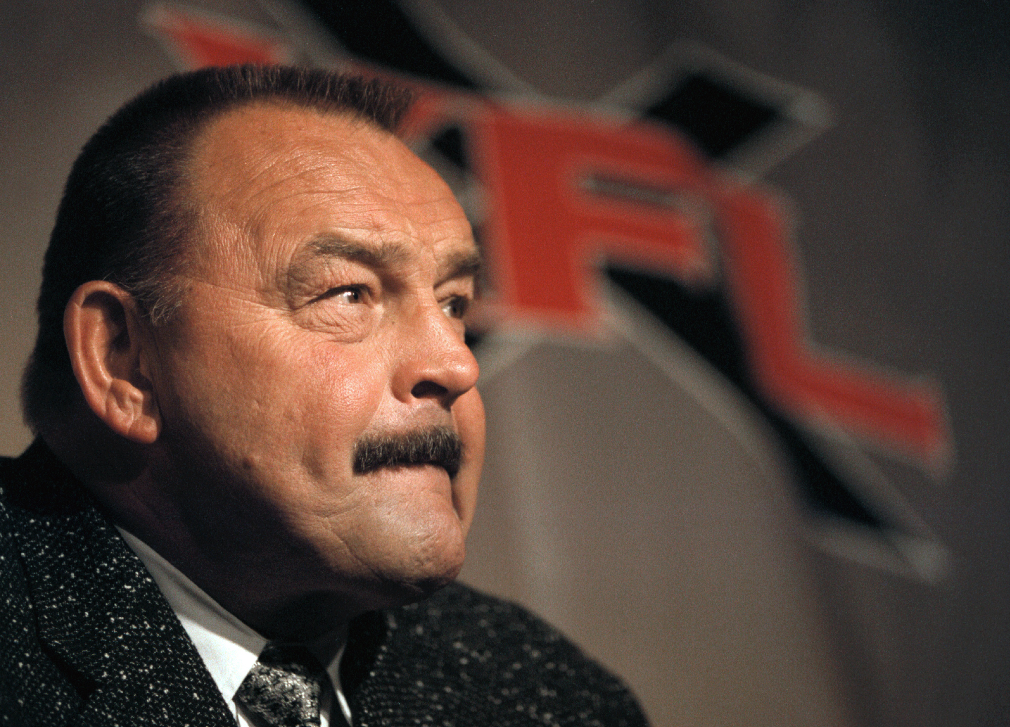 373444 03: NFL Hall of Famer and legendary Chicago Bear linebacker and actor Dick Butkus ponders a reporter's question during a press conference July 19, 2000 in Chicago, IL. Butkus was announced Head Coach of Chicago's XFL football team, and will begin p