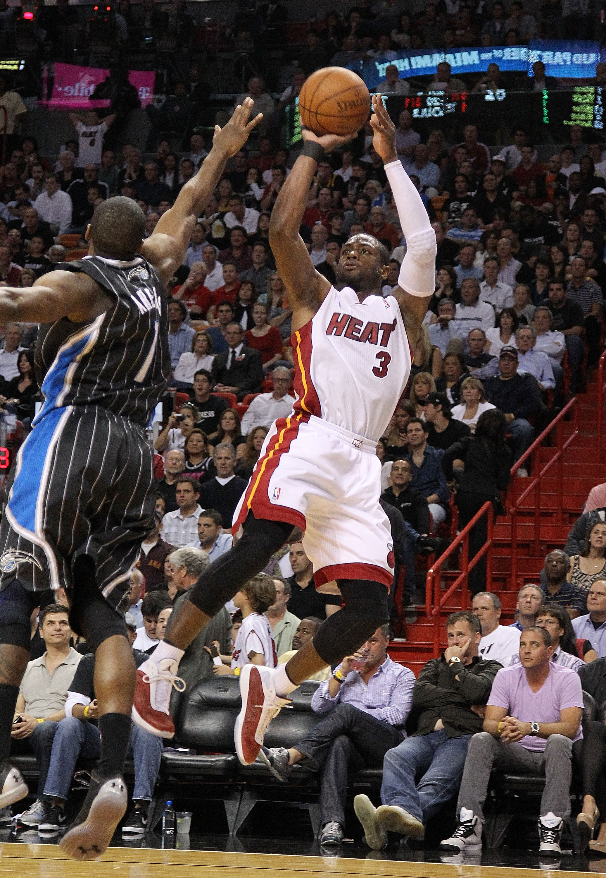 MIAMI, FL - MARCH 03:  Dwyane Wade #3 of the Miami Heat shoots over Gilbert Arenas #1 of the Orlando Magic during a game at American Airlines Arena on March 3, 2011 in Miami, Florida. NOTE TO USER: User expressly acknowledges and agrees that, by downloadi