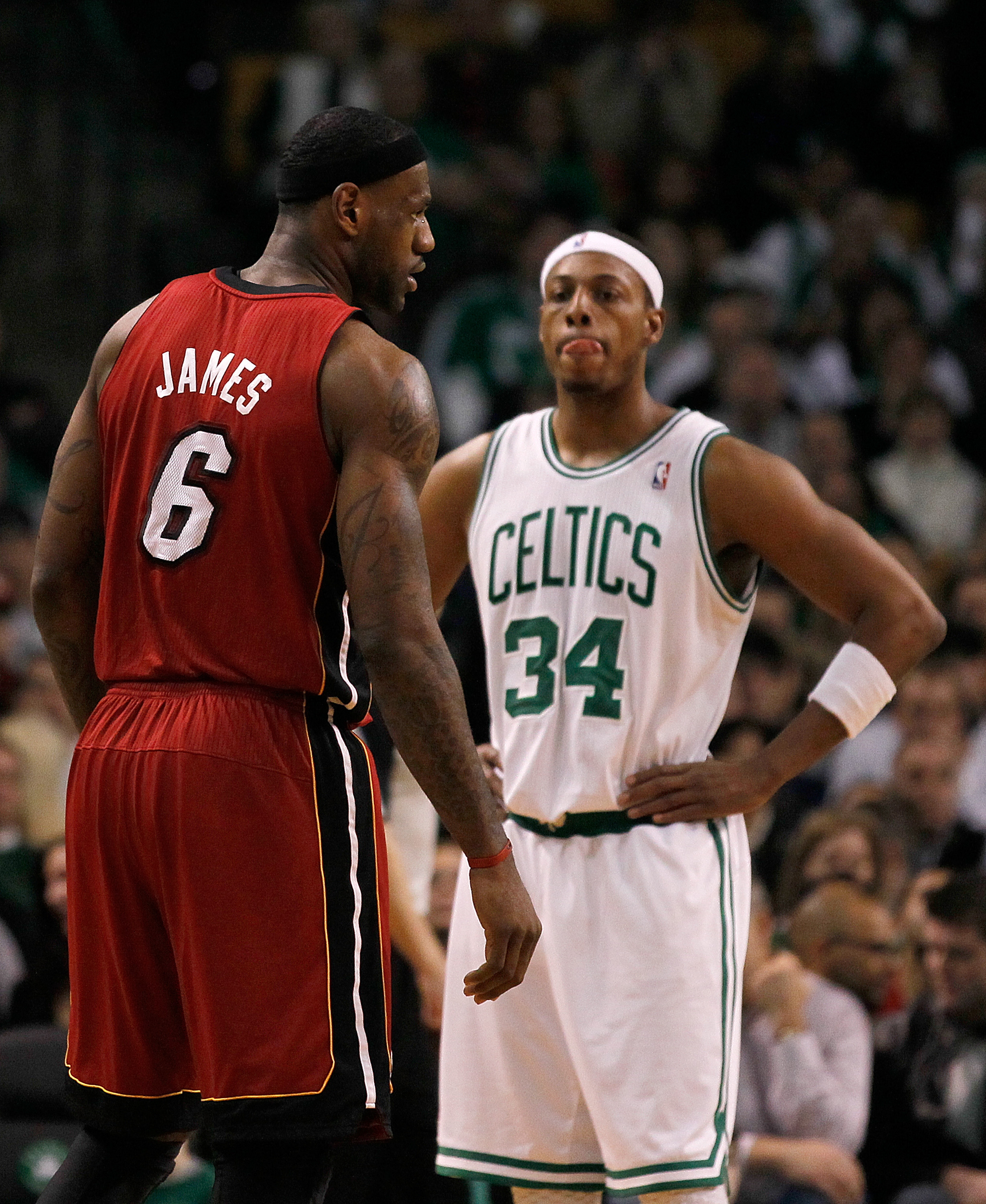 BOSTON - FEBRUARY 13:  LeBron James #6 of the Miami Heat and Paul Pierce #34 of the Boston Celtics take a breather at TD Garden on February 13, 2011 in Boston, Massachusetts. NOTE TO USER: User expressly acknowledges and agrees that, by downloading and/or