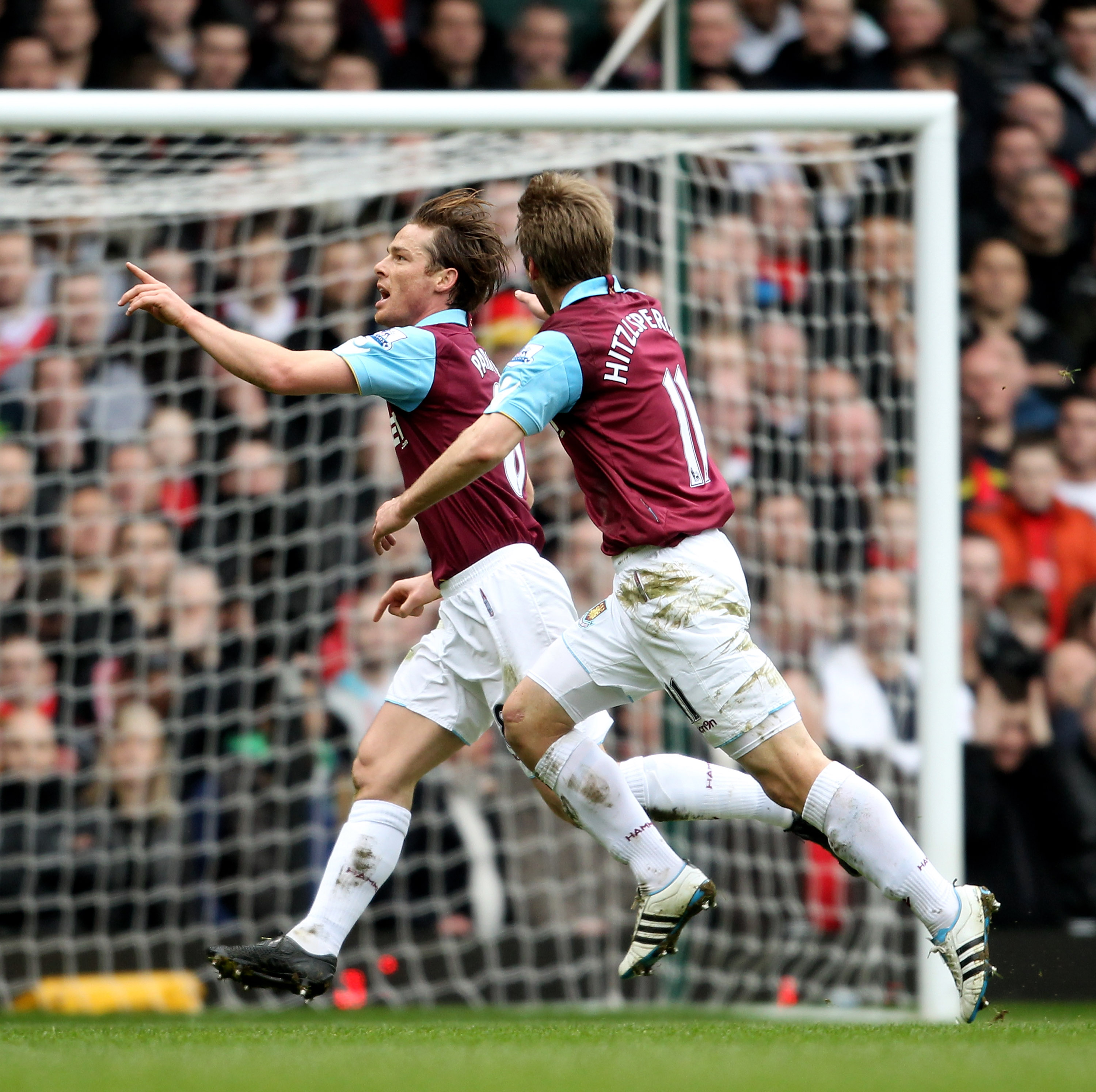 LONDON, ENGLAND - FEBRUARY 27:  Scott Parker (L) of West Ham celebrates with teammate Thomas Hitzlsperger as he scores the opening goal during the Barclays Premier League match between West Ham United and Liverpool at the Boleyn Ground on February 27, 201