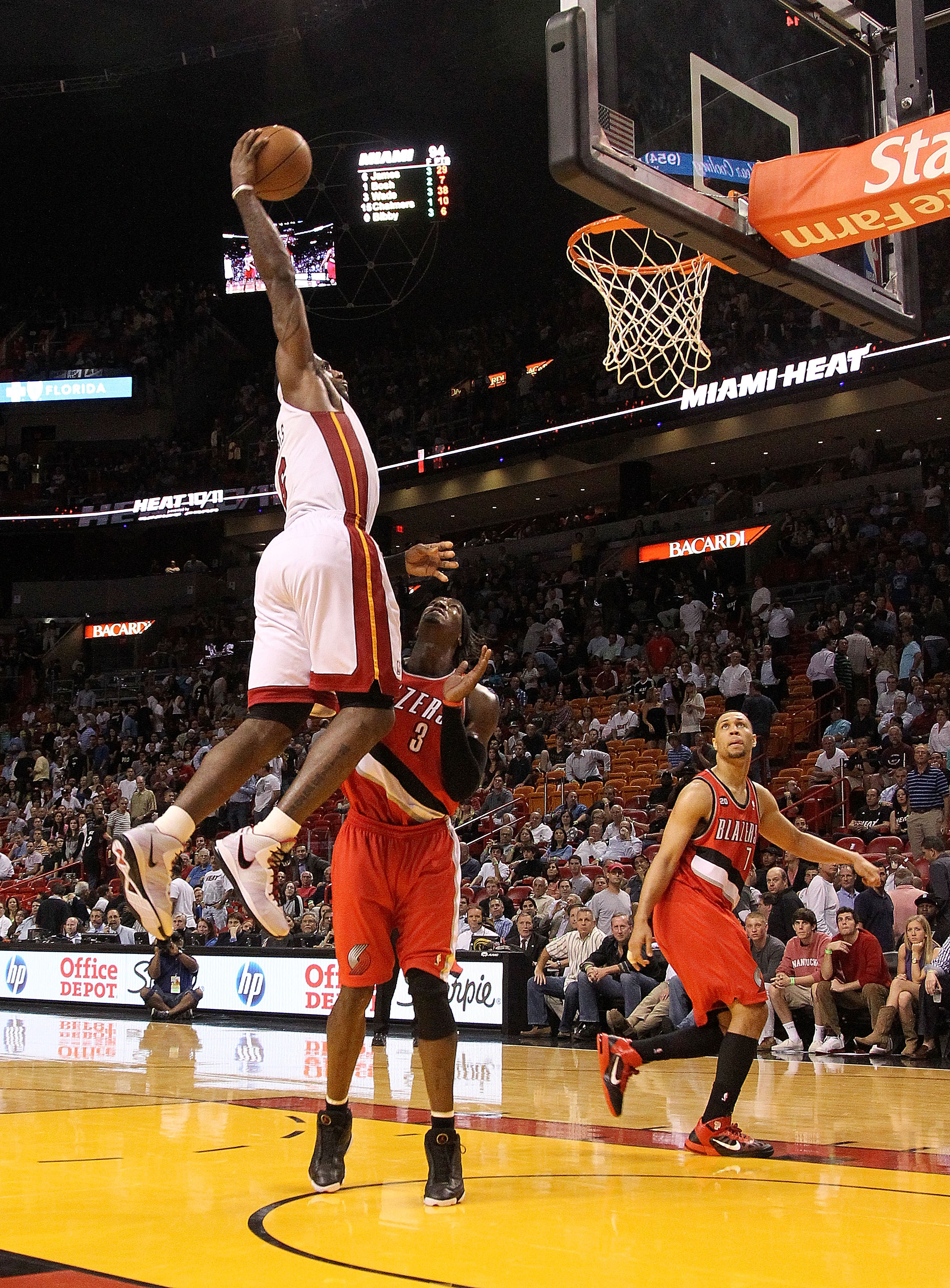 MIAMI, FL - MARCH 08:  LeBron James #6 of the Miami Heat dunks over Gerald Wallace #3 of the Portland Trail Blazers during a game at American Airlines Arena on March 8, 2011 in Miami, Florida. NOTE TO USER: User expressly acknowledges and agrees that, by