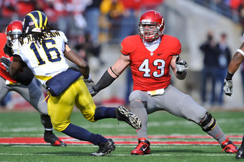 COLUMBUS, OH - NOVEMBER 27:  Nathan Williams #43 of the Ohio State Buckeyes defends against Denard Robinson #16 of the Michigan Wolverines at Ohio Stadium on November 27, 2010 in Columbus, Ohio.  (Photo by Jamie Sabau/Getty Images)