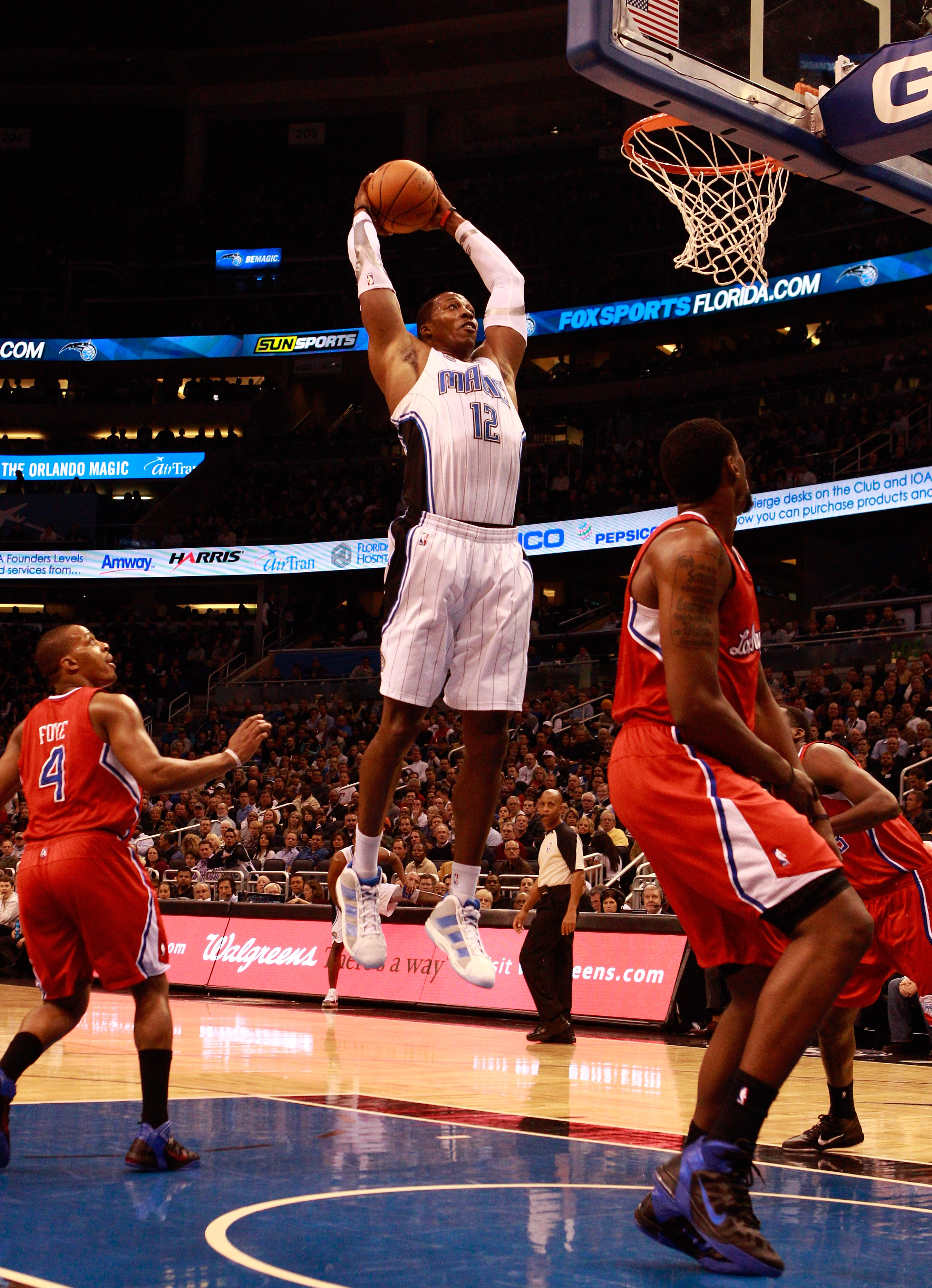 ORLANDO, FL - FEBRUARY 08:  Dwight Howard #12 of the Orlando Magic attempts a shot during a game against the Los Angeles Clippers at Amway Arena on February 8, 2011 in Orlando, Florida.  NOTE TO USER: User expressly acknowledges and agrees that, by downlo