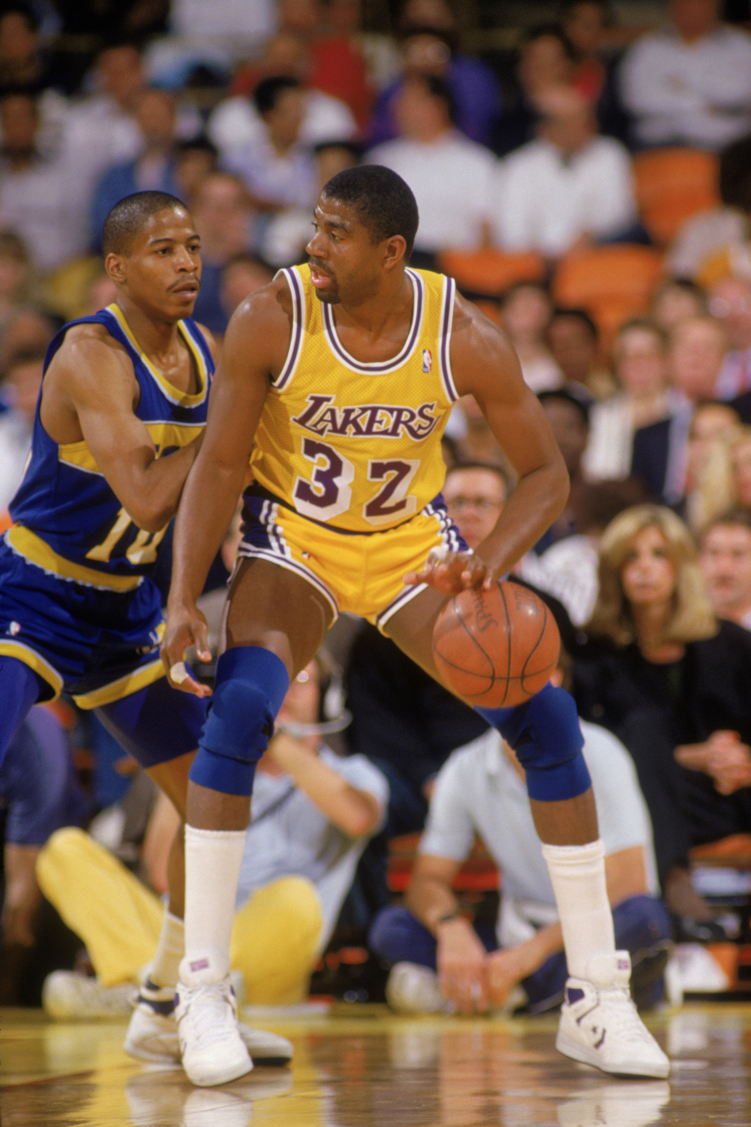 LOS ANGELES - 1987:  Magic Johnson #32 of the Los Angeles Lakers dribbles the ball in the post during an NBA game against the Golden State Warriors at the Great Western Forum in Los Angeles, California in 1987. (Photo by: Stephen Dunn/Getty Images)