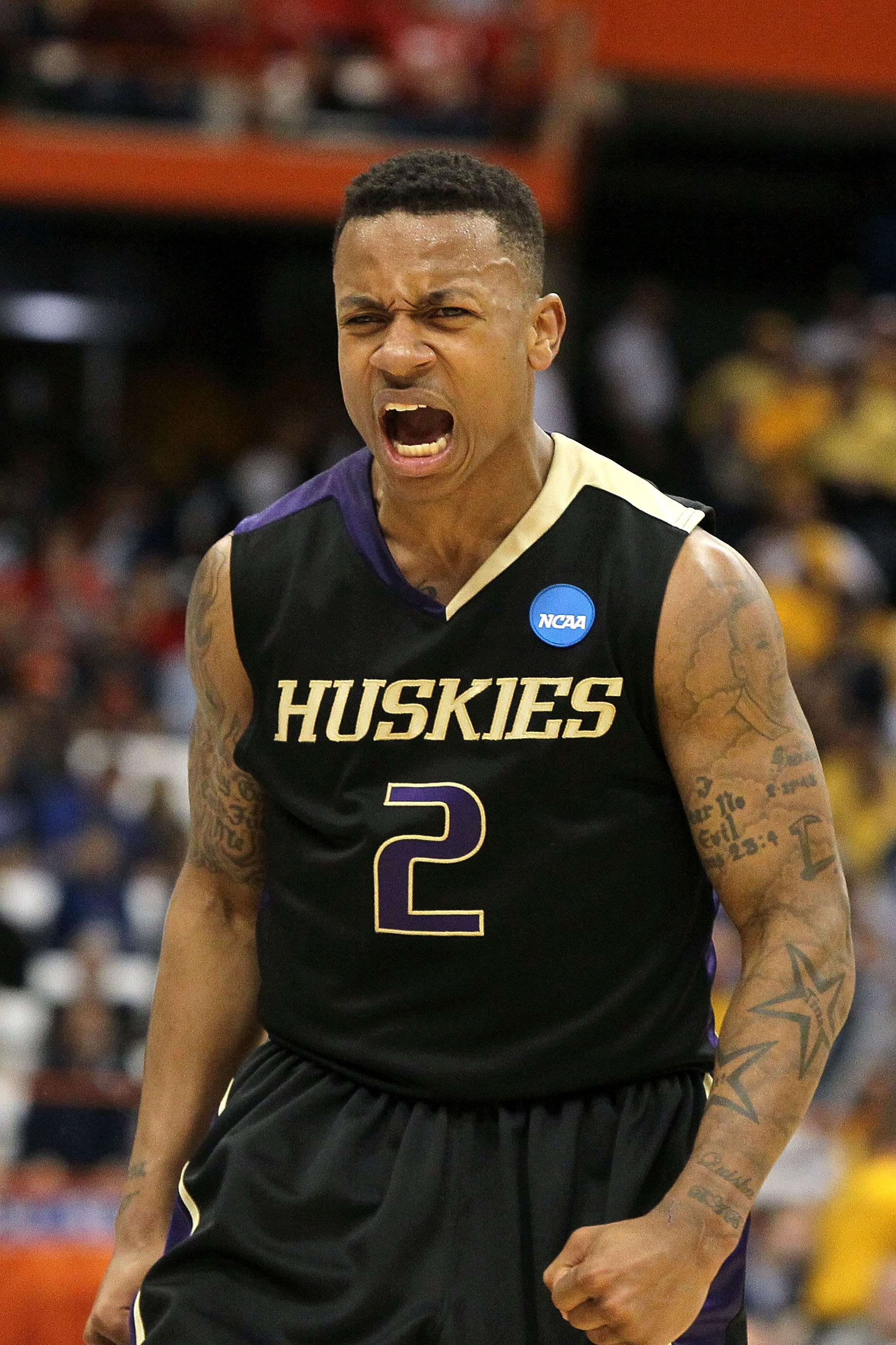 SYRACUSE, NY - MARCH 25:  Isaiah Thomas #2 of the Washington Huskies reacts against the West Virginia Mountaineers during the east regional semifinal of the 2010 NCAA men's basketball tournament at the Carrier Dome on March 25, 2010 in Syracuse, New York.