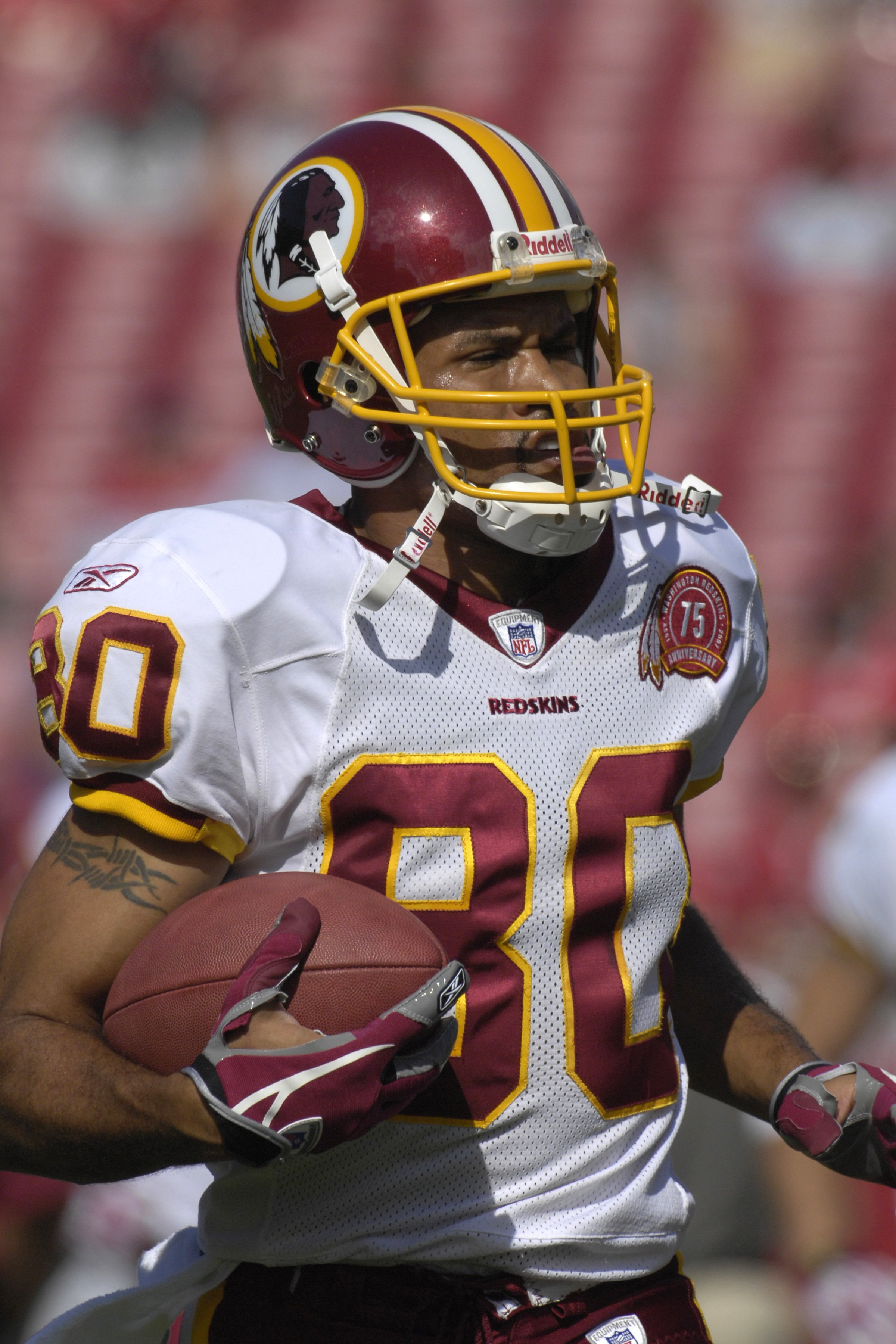 TAMPA, FL - NOVEMBER 25: Wide receiver Keenan McCardell #80 of the Washington Redskins grabs a warm up pass before play against the Tampa Bay Buccaneers at the Raymond James Stadium on November 25, 2007 in Tampa, Florida.  The Bucs won 19-13. (Photo by Al