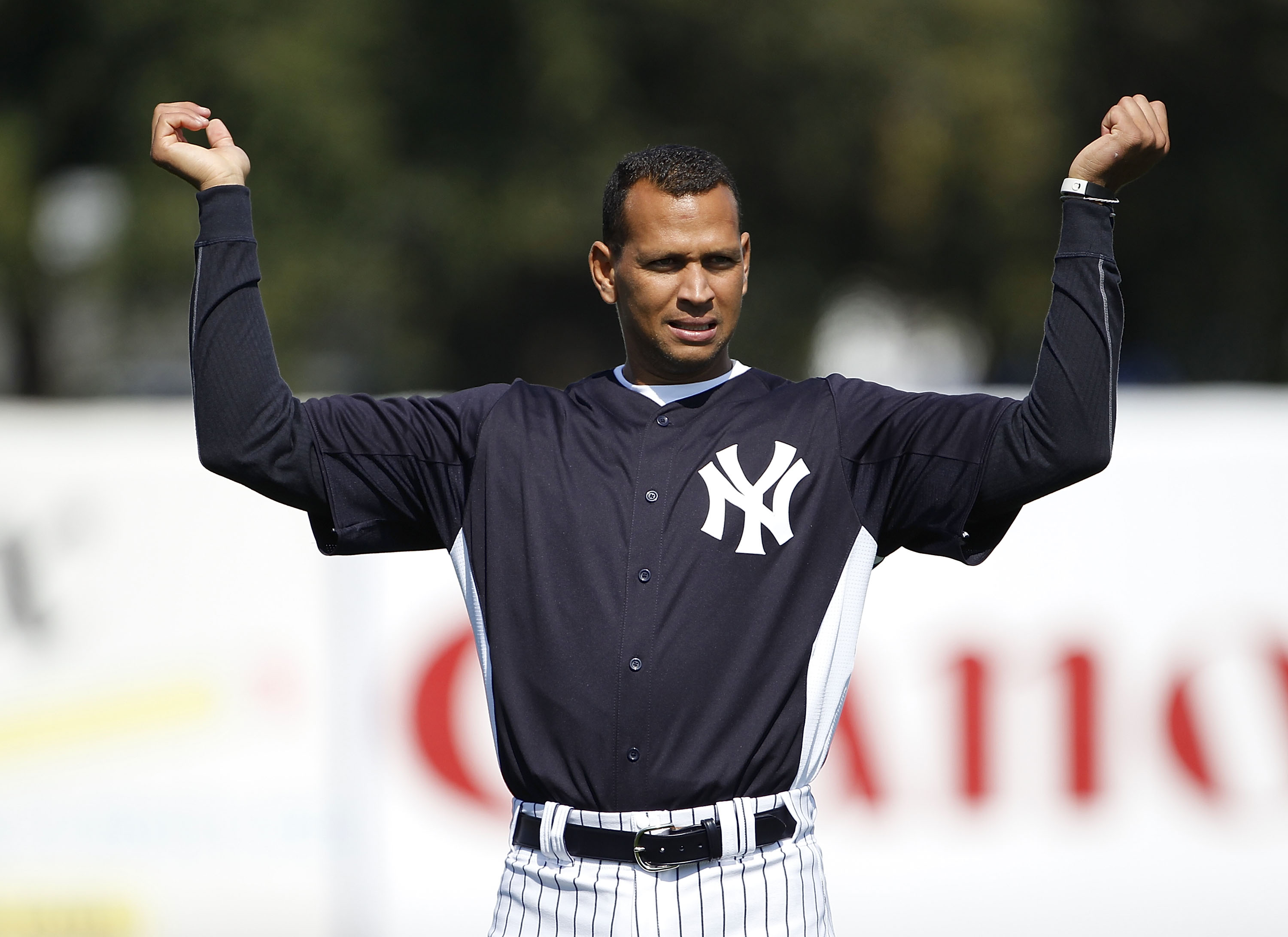 TAMPA, FL - FEBRUARY 20: Alex Rodriguez #13 of the New York Yankees stretches prior to the start if the first full team workout of Spring Training on February 20, 2011 at the George M. Steinbrenner Field in Tampa, Florida.  (Photo by Leon Halip/Getty Imag