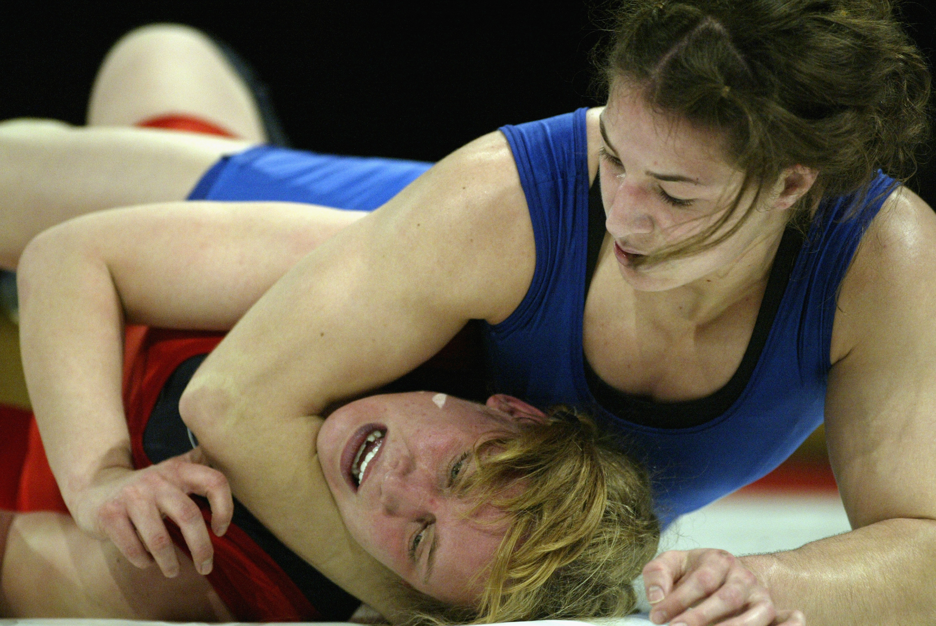 SAN JOSE, CA - FEBRUARY 14:  Sara McMann (R)of the USA competes against Trish Liebel of Canada during the wrestling portion of the Titan Games at the Events Center at San Jose State on Febraury 14, 2003 in San Jose, California.  (Photo by Jed Jacobsohn/Ge