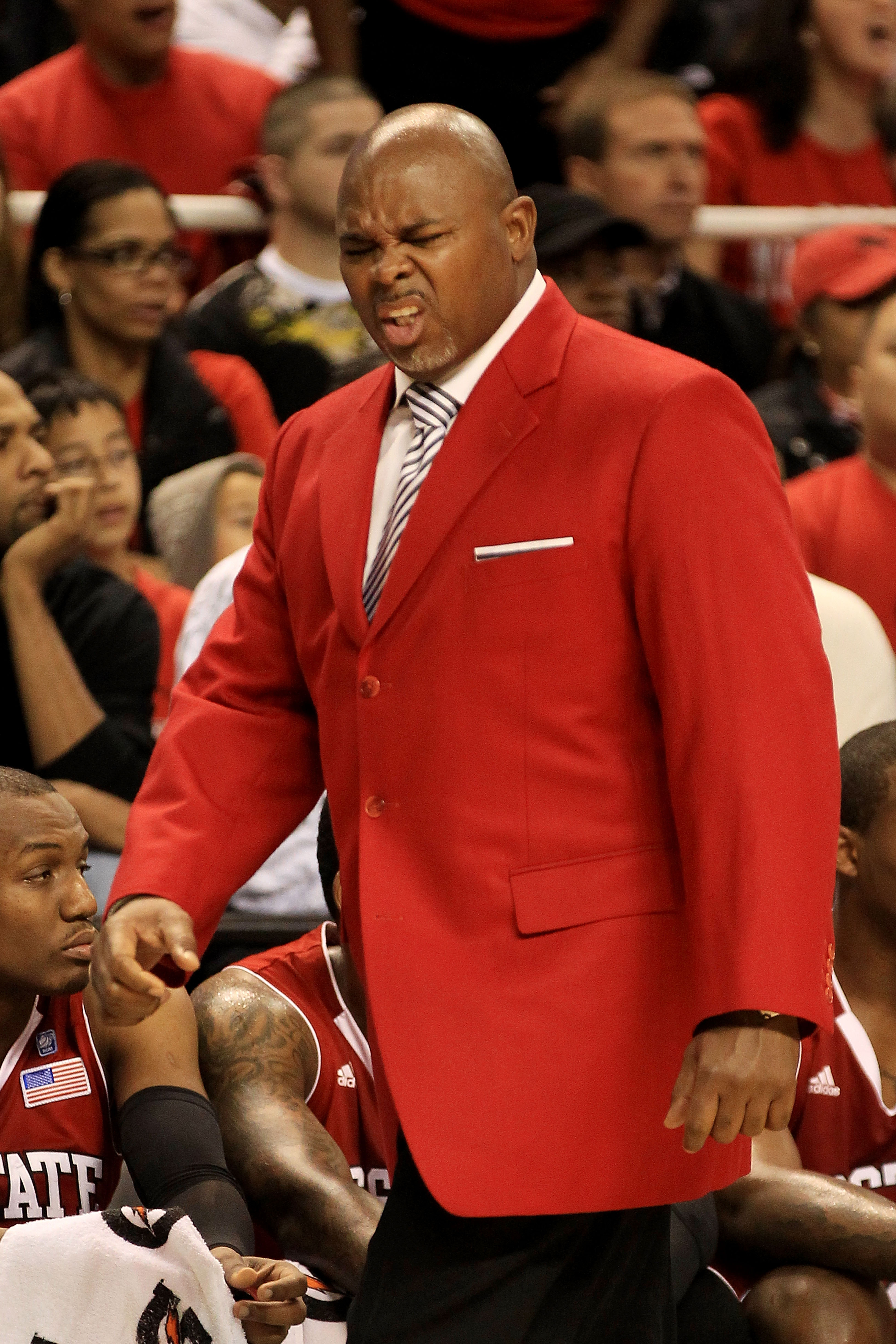 GREENSBORO, NC - MARCH 10:  Head coach Sidney Lowe of the North Carolina State Wolfpack reacts during the first half of the game against the Maryland Terrapins in the first round of the 2011 ACC men's basketball tournament at the Greensboro Coliseum on Ma