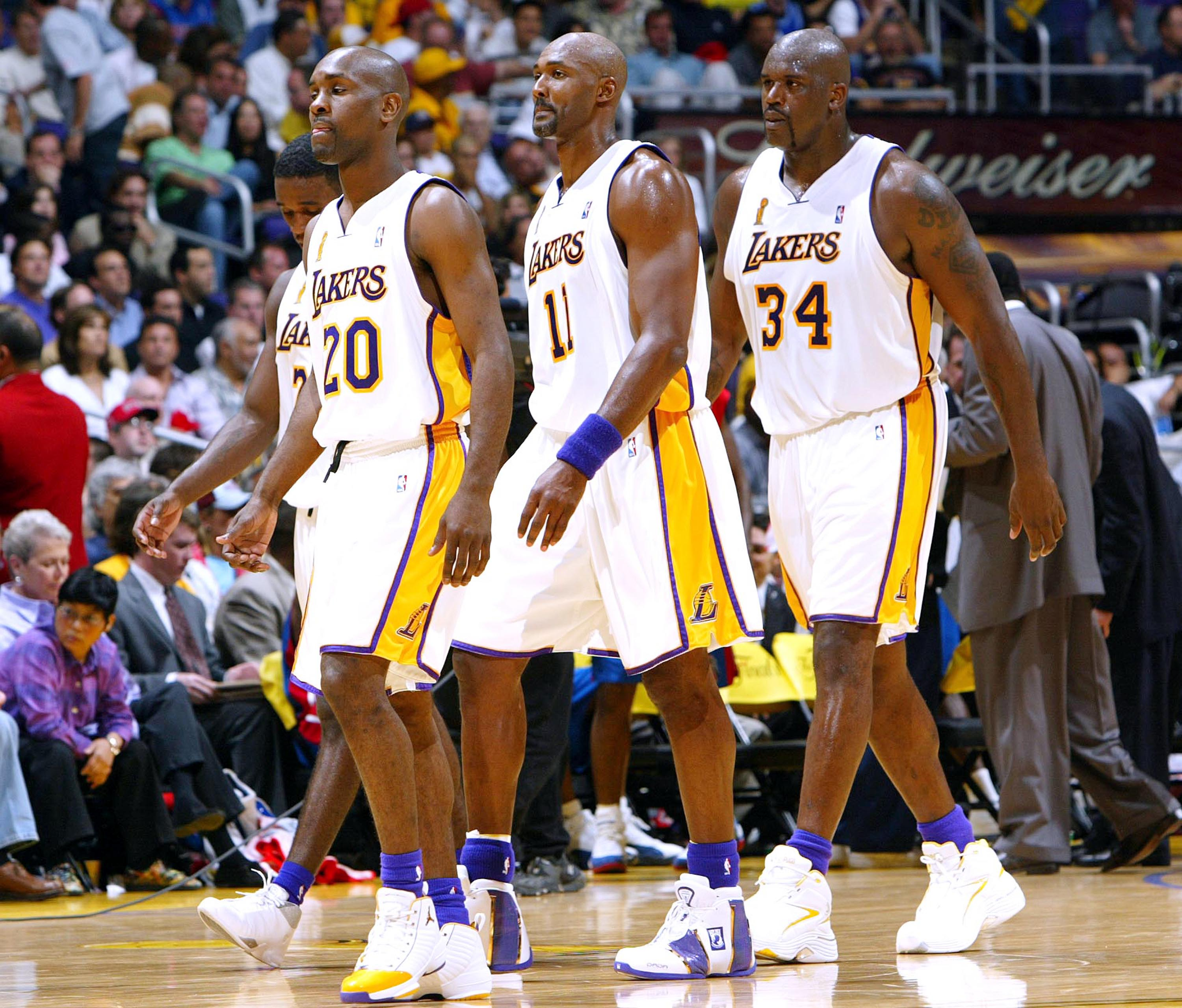 LOS ANGELES - JUNE 6:  Gary Payton #20, Kareem Rush #21, Karl Malone #11 and Shaquille O'Neal #34 of the Los Angeles Lakers walk off the court in Game 1 of the 2004 NBA Finals against the Detroit Pistons on June 6, 2004 at Staples Center in Los Angeles, C
