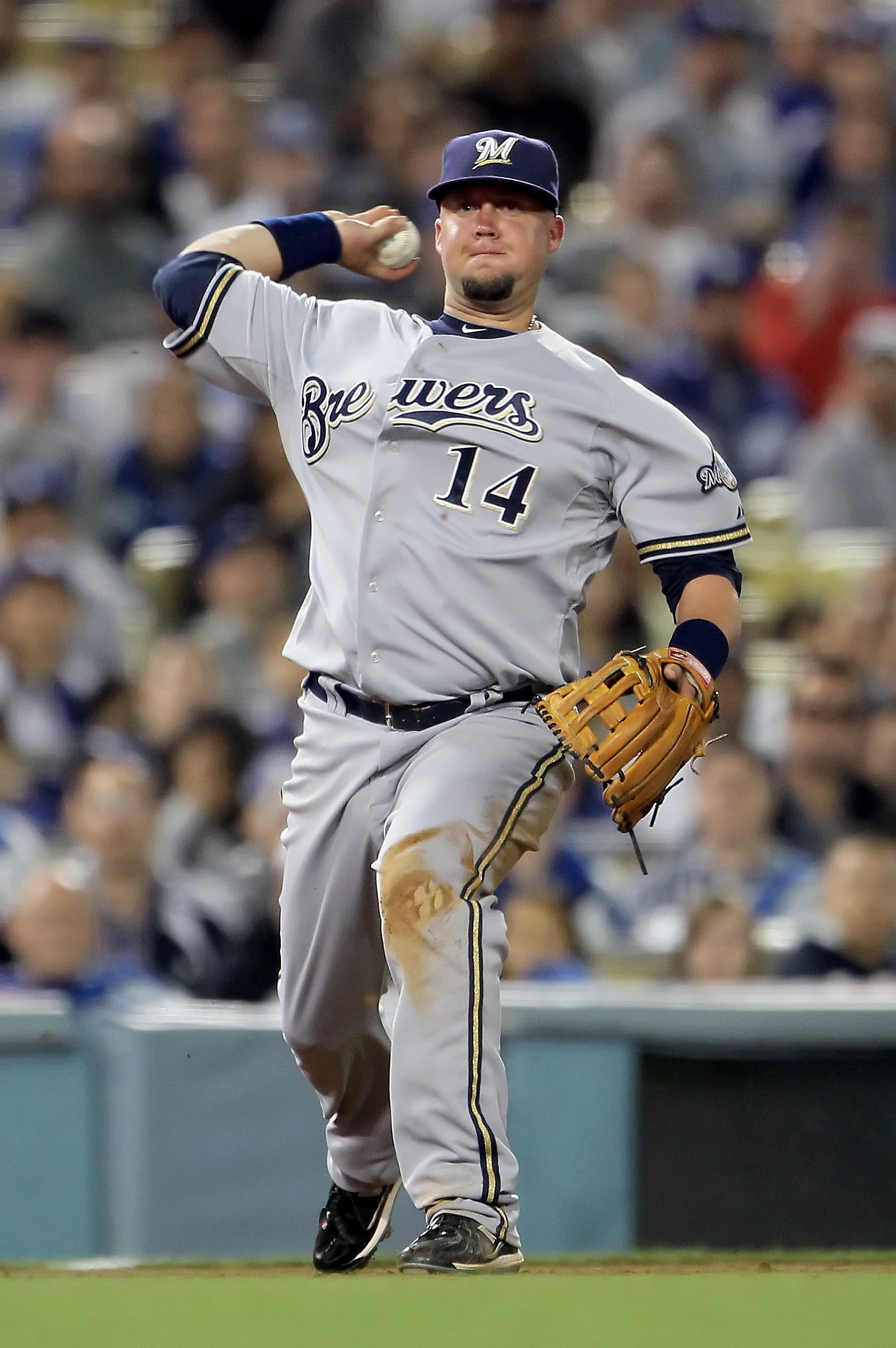 LOS ANGELES, CA - MAY 04:  Casey McGehee #14 of the Milwaukee Brewers throws to first base against the Los Angeles Dodgers at Dodger Stadium on May 4, 2010 in Los Angeles, California. The Brewers defeated the Dodgers 11-6.  (Photo by Jeff Gross/Getty Imag