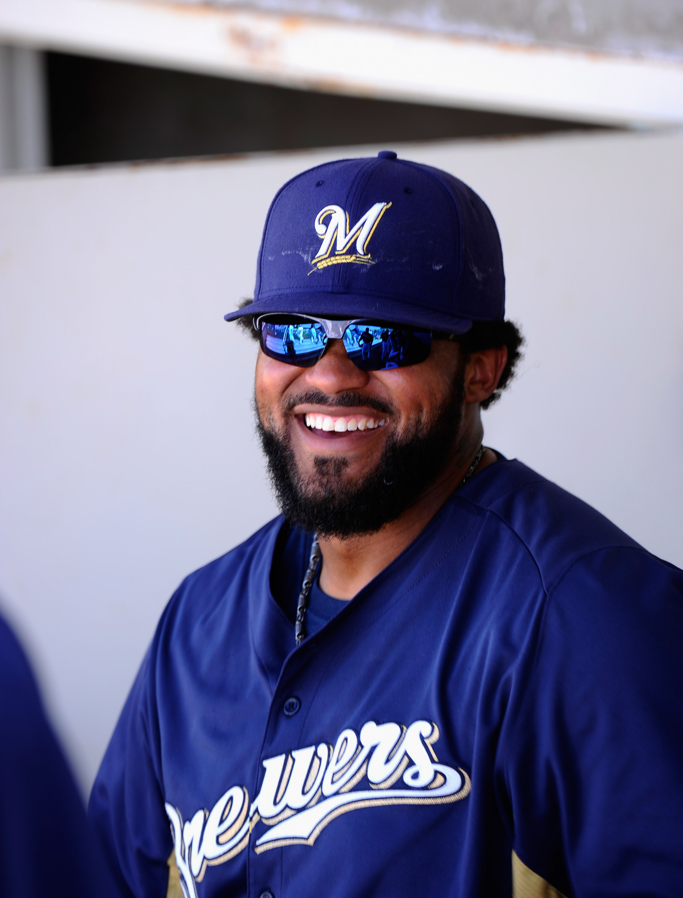 PHOENIX, AZ - MARCH 10:  Prince Fielder#28 of the Milwaukee Brewers in the dugout against the Colorado Rockies during spring training baseball game at Maryvale Baseball Park on March 10, 2011 in Phoenix, Arizona.  (Photo by Kevork Djansezian/Getty Images)