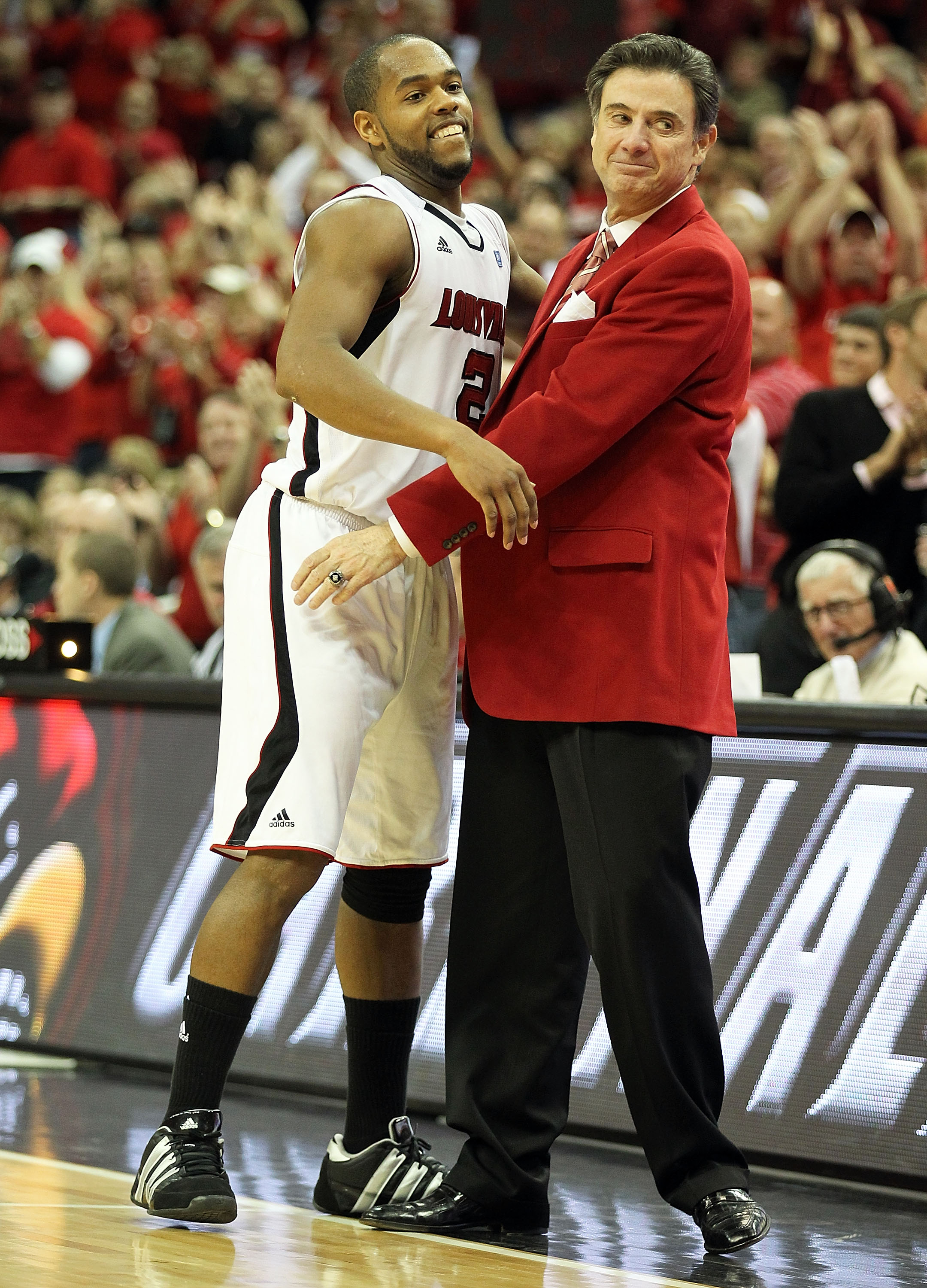 LOUISVILLE, KY - MARCH 02:  Rick Pitino the Head Coach of the Louisville Cardinals hugs Preston Knowles #2 in the final minute of the game during the Big East Conference game against the Providence Friars at the KFC Yum! Center on March 2, 2011 in Louisvi