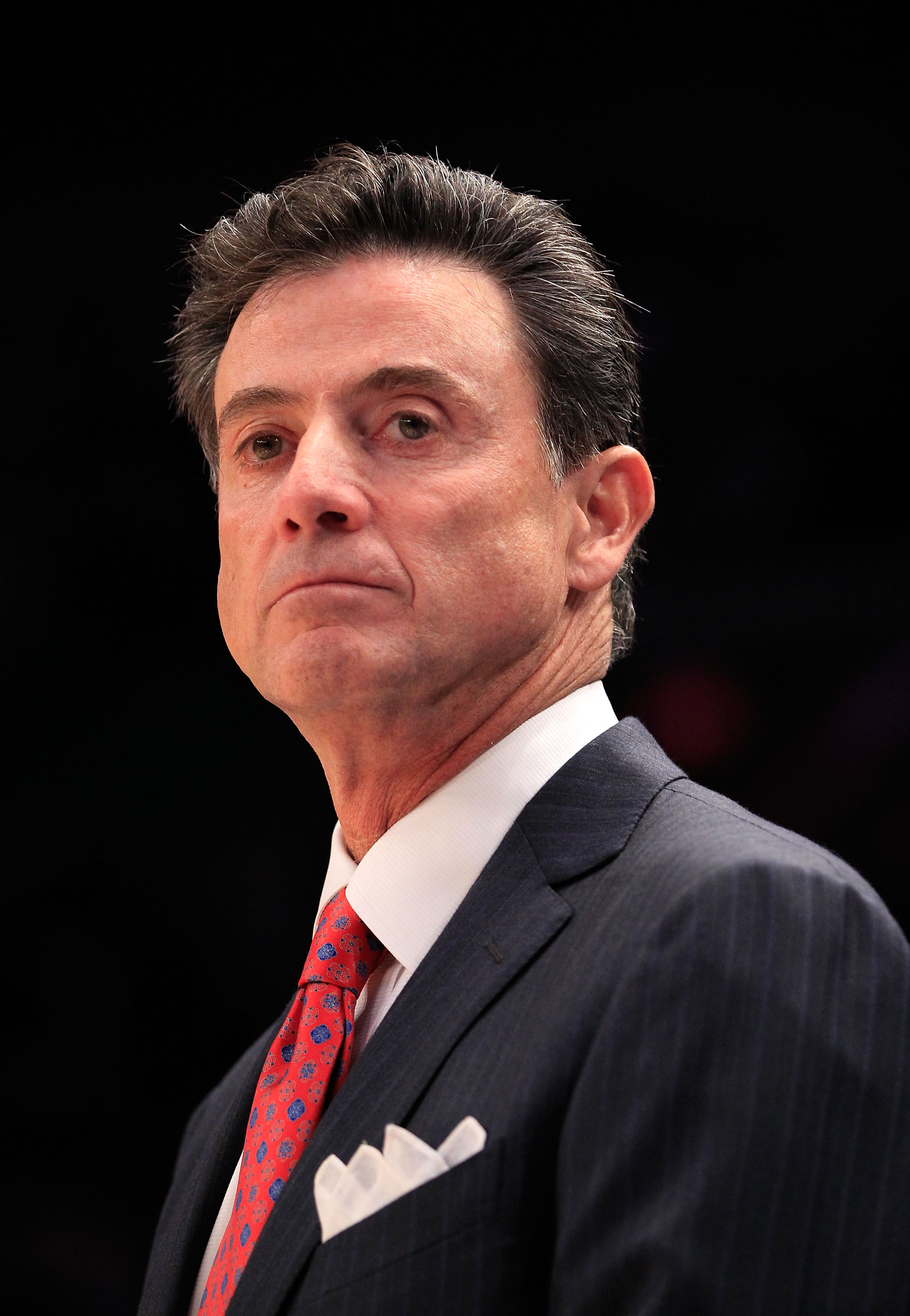 NEW YORK, NY - MARCH 10: Head coach Rick Pitino of the Louisville Cardinals looks on from the bench during the game against the Marquette Golden Eagles during the quarterfinals of the 2011 Big East Men's Basketball Tournament presented by American Eagle O