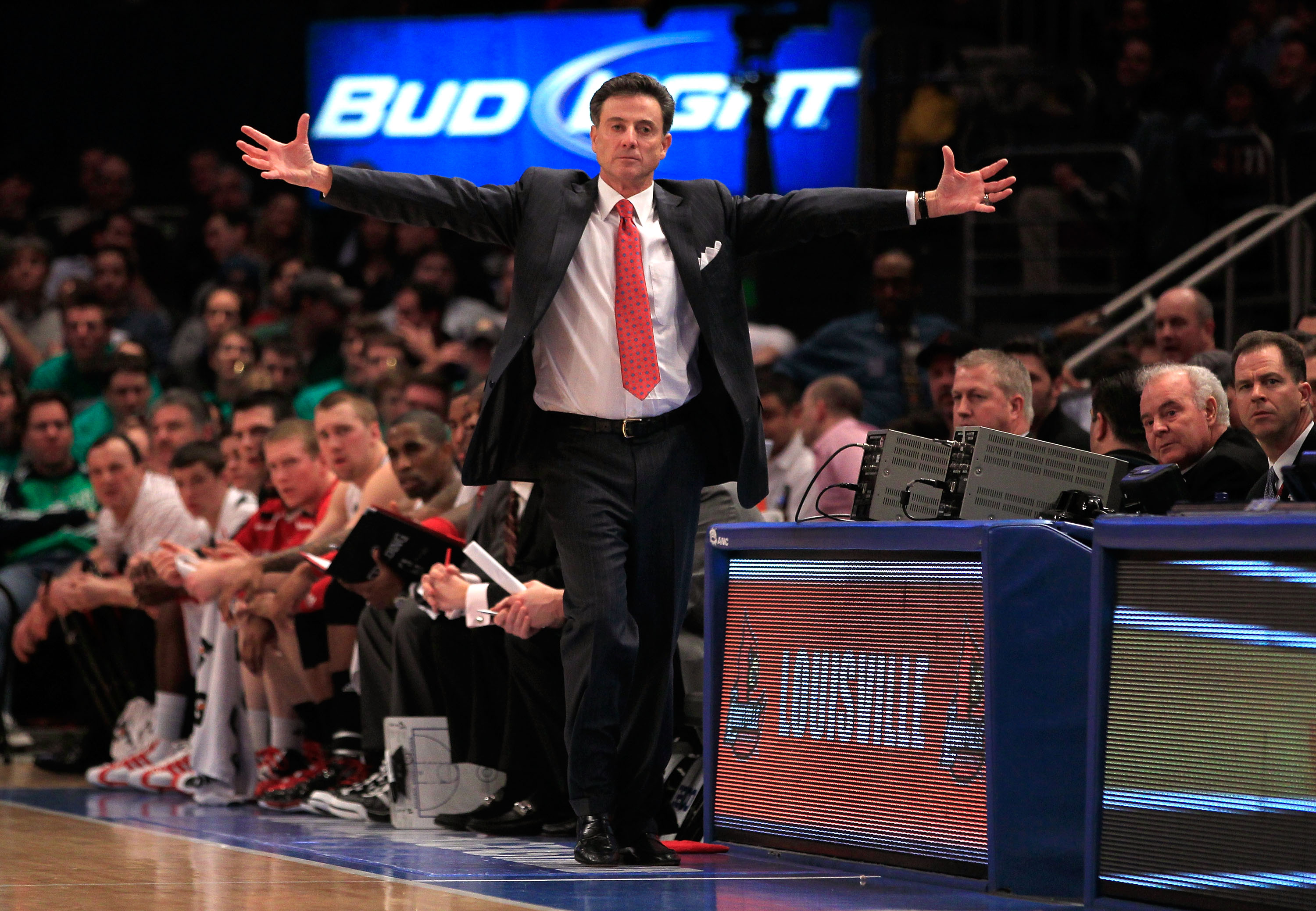 NEW YORK, NY - MARCH 10: Head coach Rick Pitino of the Louisville Cardinals gestures from the bench during the game against the Marquette Golden Eagles during the quarterfinals of the 2011 Big East Men's Basketball Tournament presented by American Eagle O