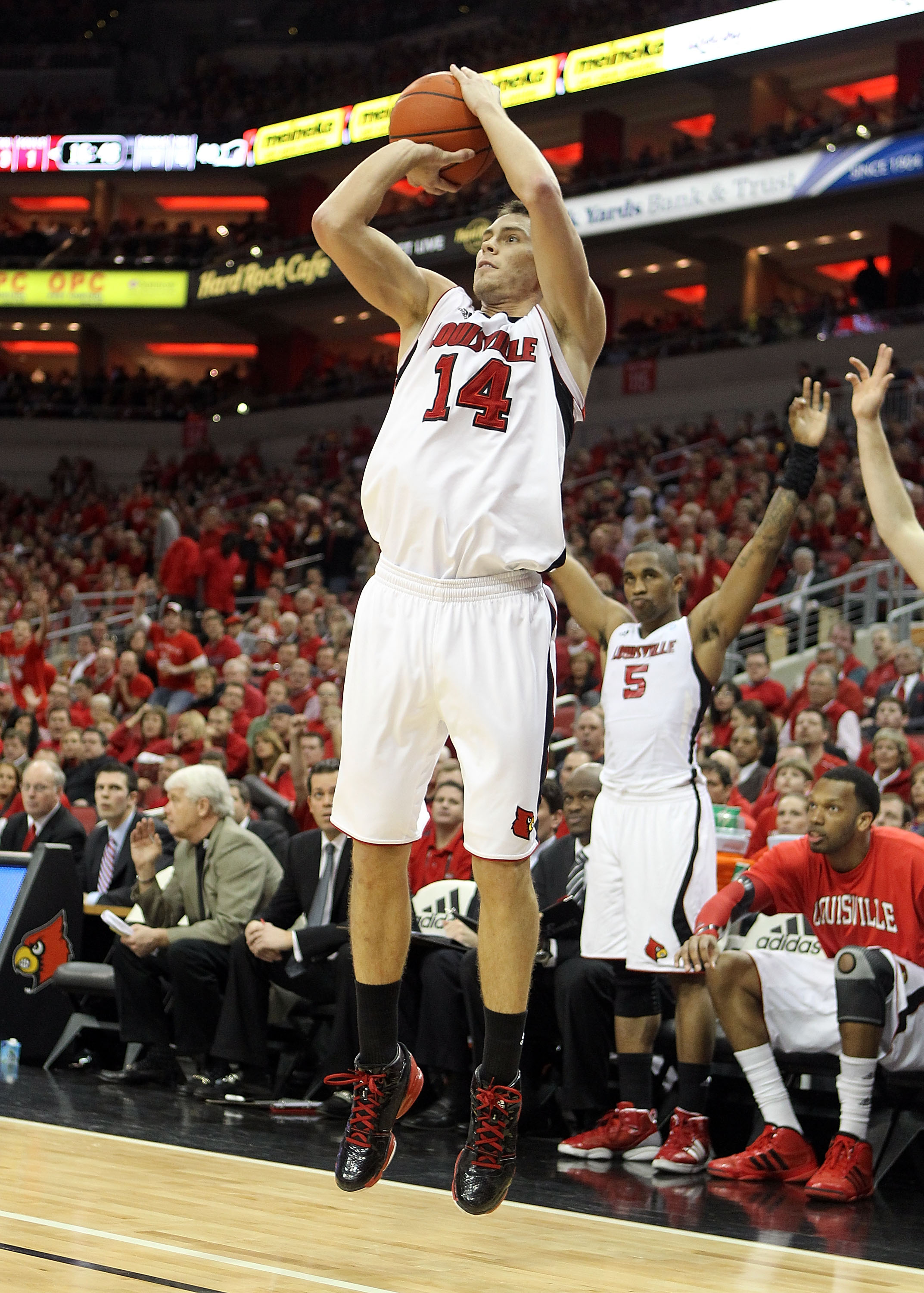 LOUISVILLE, KY - MARCH 02:  Kyle Kuric #14 of the Louisville Cardinals shoots the ball during the Big East Conference game against the Providence Friars at the KFC Yum! Center on March 2, 2011 in Louisville, Kentucky. Louisville won 87-60.  (Photo by Andy