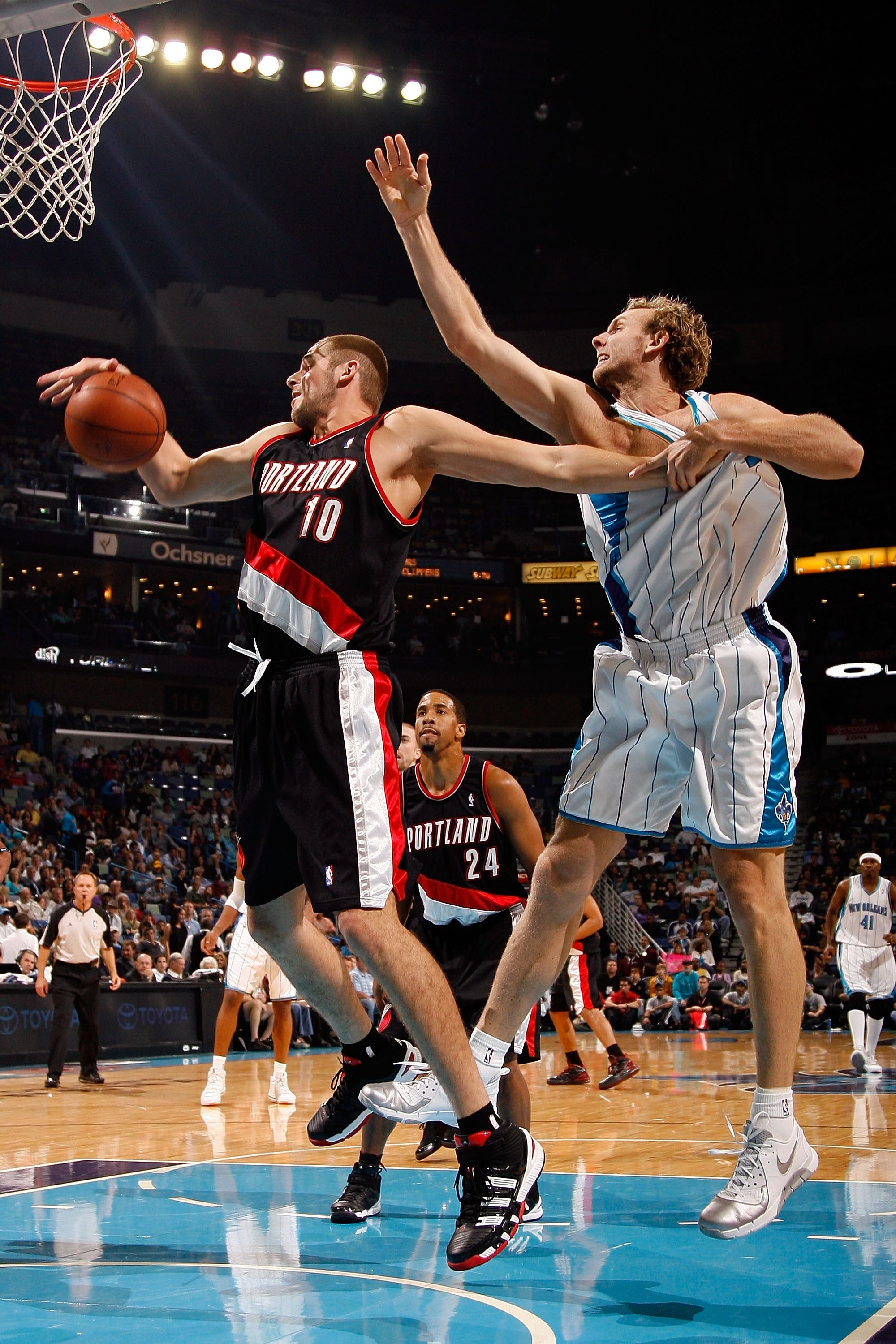 NEW ORLEANS - NOVEMBER 13:  Joel Przybilla #10 of the Portland Trail Blazers fights for a rebound with Sean Marks #4 of the New Orleans Hornets at the New Orleans Arena on November 13, 2009 in New Orleans, Louisiana.  NOTE TO USER: User expressly acknowle
