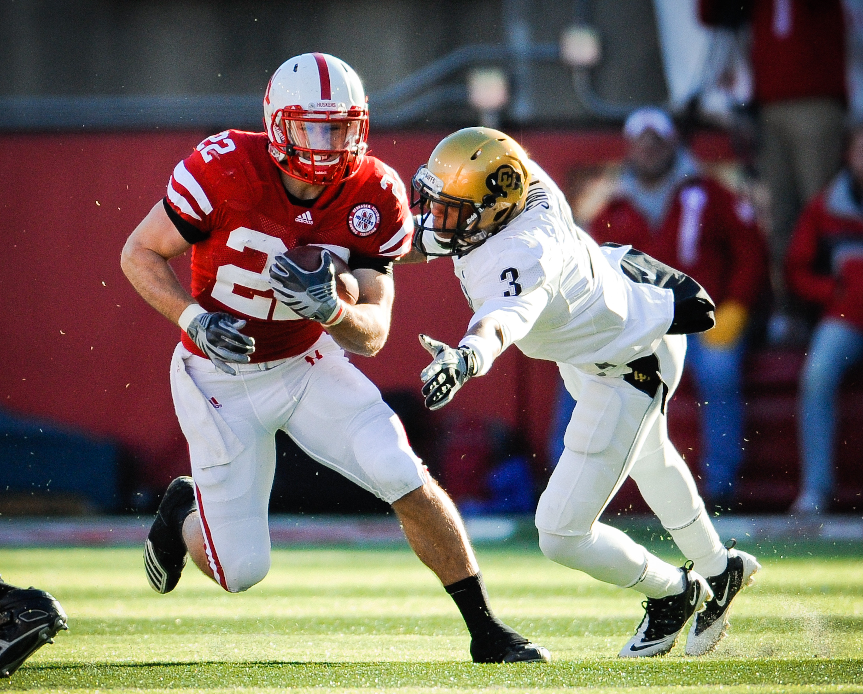 LINCOLN, NE - NOVEMBER 26: Rex Burkhead #22 of the Nebraska Cornhuskers slips past Jimmy Smith #3 of the Colorado Buffaloes during their game at Memorial Stadium on November 26, 2010 in Lincoln, Nebraska. Nebraska defeated Colorado 45-17 (Photo by Eric Fr