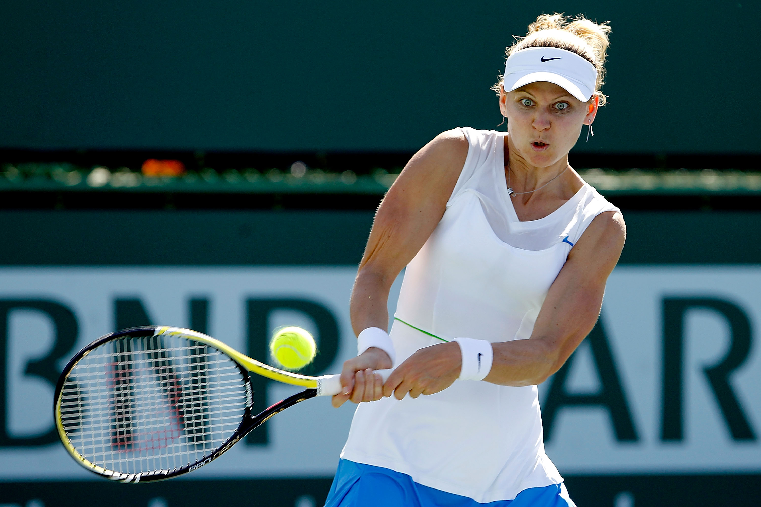 INDIAN WELLS, CA - MARCH 09:  Lucie Safarova of the Czech Republic returns a shot to Kristina Barrois of Germany during the BNP Paribas Open at the Indian Wells Tennis Garden on March 9, 2011 in Indian Wells, California.  (Photo by Matthew Stockman/Getty