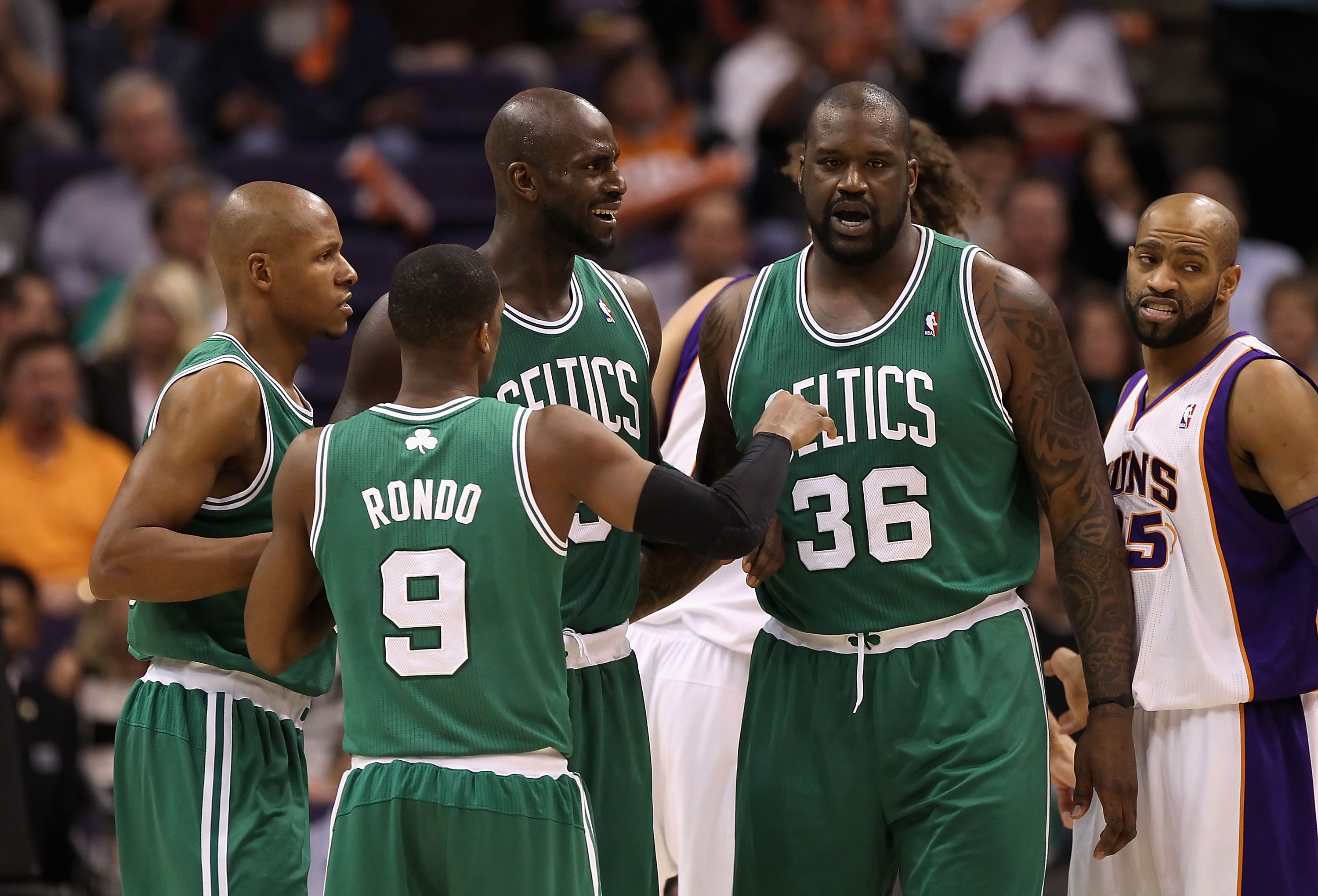 PHOENIX, AZ - JANUARY 28:  Ray Allen #20, Rajon Rondo #9, Kevin Garnett #5 and Shaquille O'Neal #36 of the Boston Celtics huddle up during the NBA game against the Phoenix Suns at US Airways Center on January 28, 2011 in Phoenix, Arizona.   The Suns defea