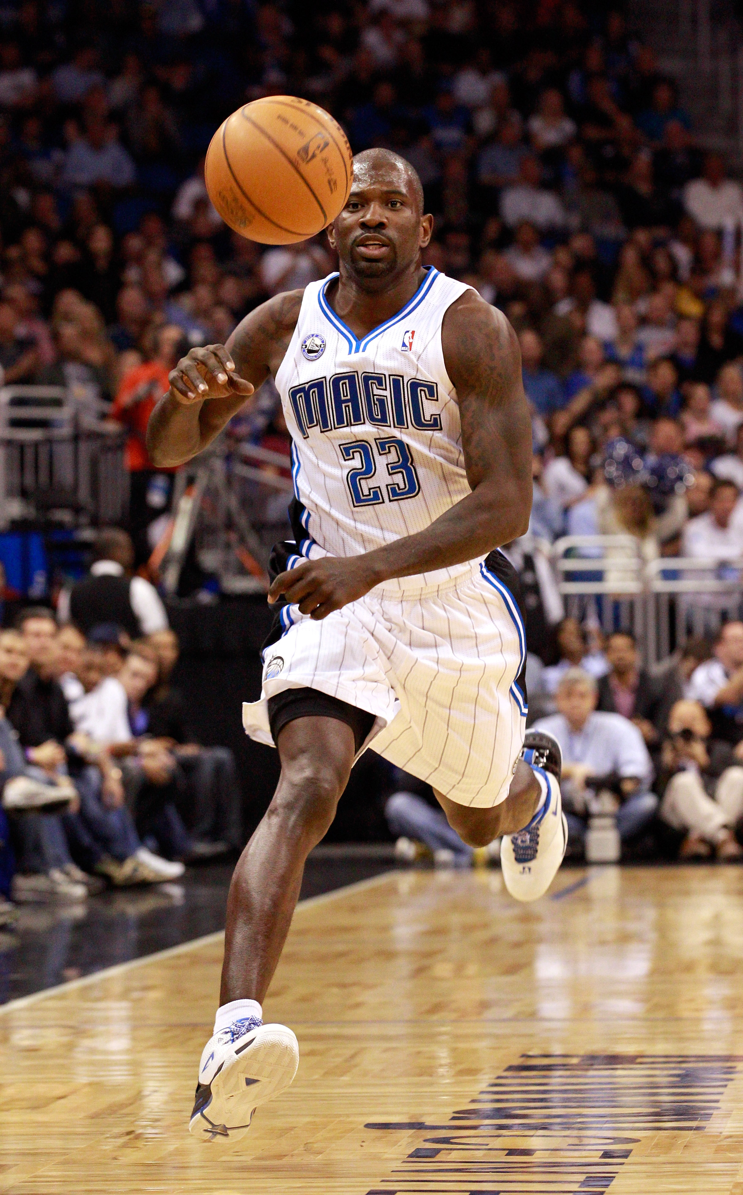 ORLANDO, FL - FEBRUARY 13:  Jason Richardson #23 of the Orlando Magic chases a loose ball during the game against the Los Angeles Lakers at Amway Arena on February 13, 2011 in Orlando, Florida.  NOTE TO USER: User expressly acknowledges and agrees that, b