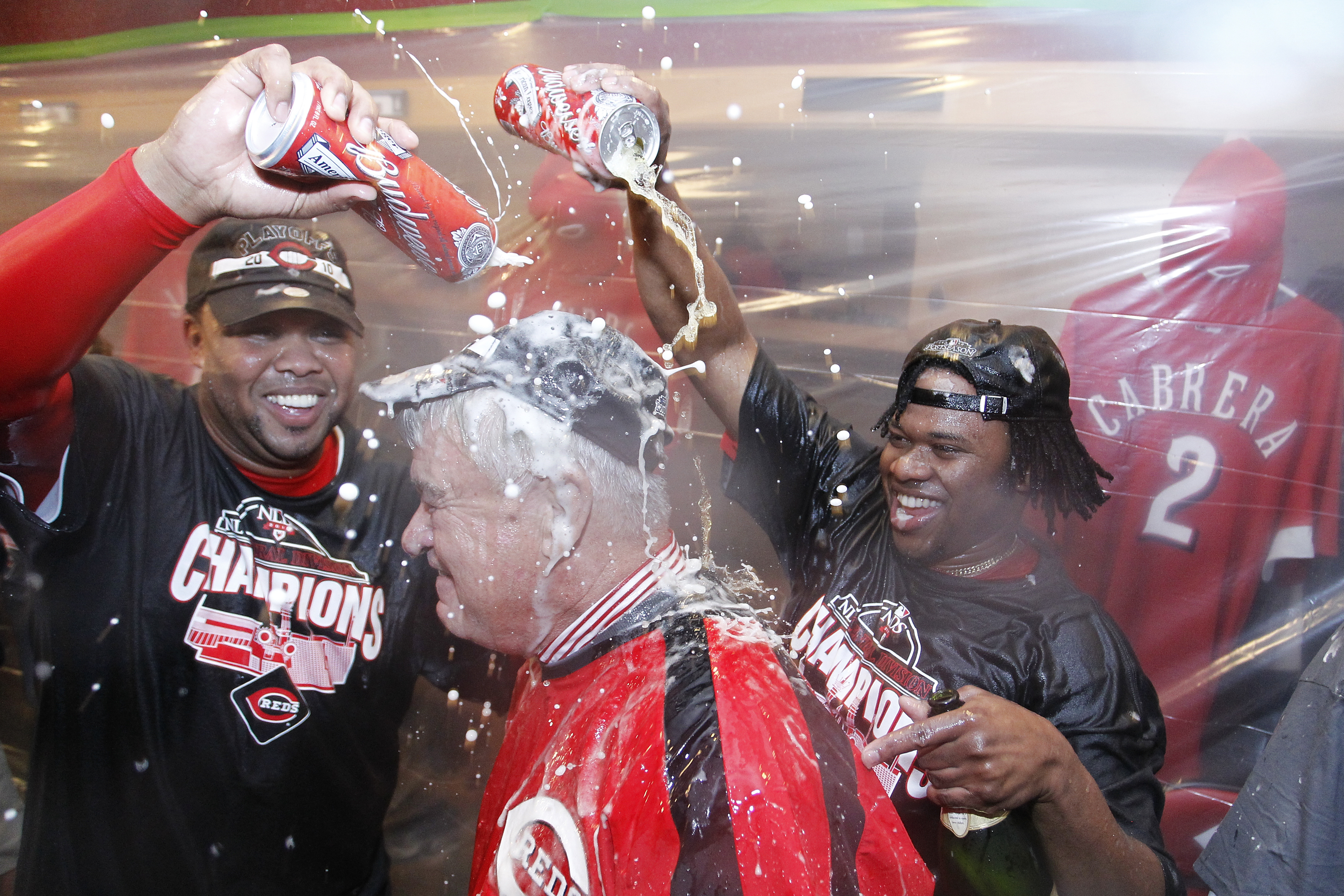 CINCINNATI, OH - SEPTEMBER 28: Johnny Cueto (R) and Francisco Cordero of the Cincinnati Reds celebrate with team president Bob Castellini following the game against the Houston Astros at Great American Ball Park on September 28, 2010 in Cincinnati, Ohio.