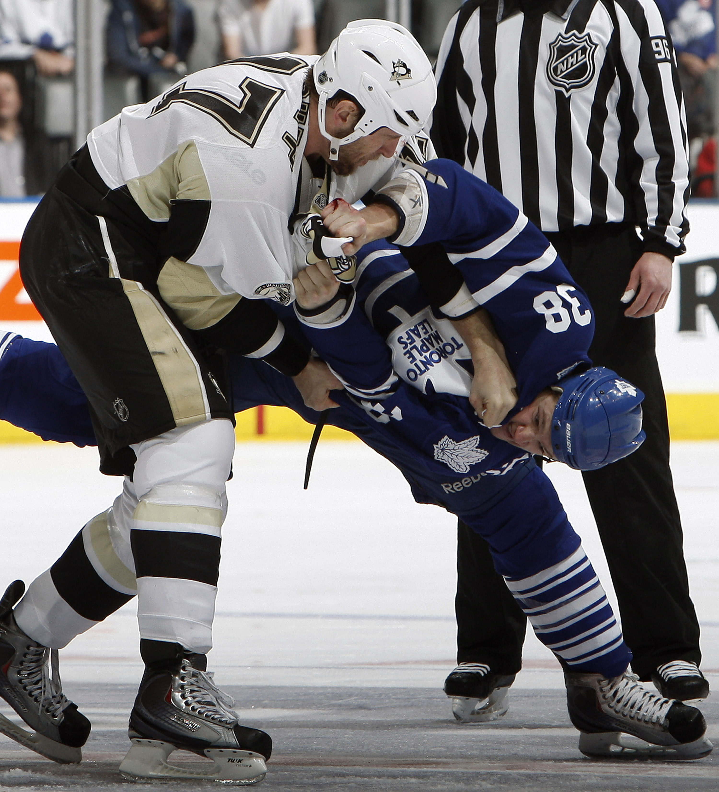 TORONTO, CANADA - FEBRUARY 26: Jay Rosehill #38 of the Toronto Maple Leafs fights Mike Rupp #17 of the Pittsburgh Penguins during game action at the Air Canada Centre February 26, 2011 in Toronto, Ontario, Canada. (Photo by Abelimages/Getty Images)