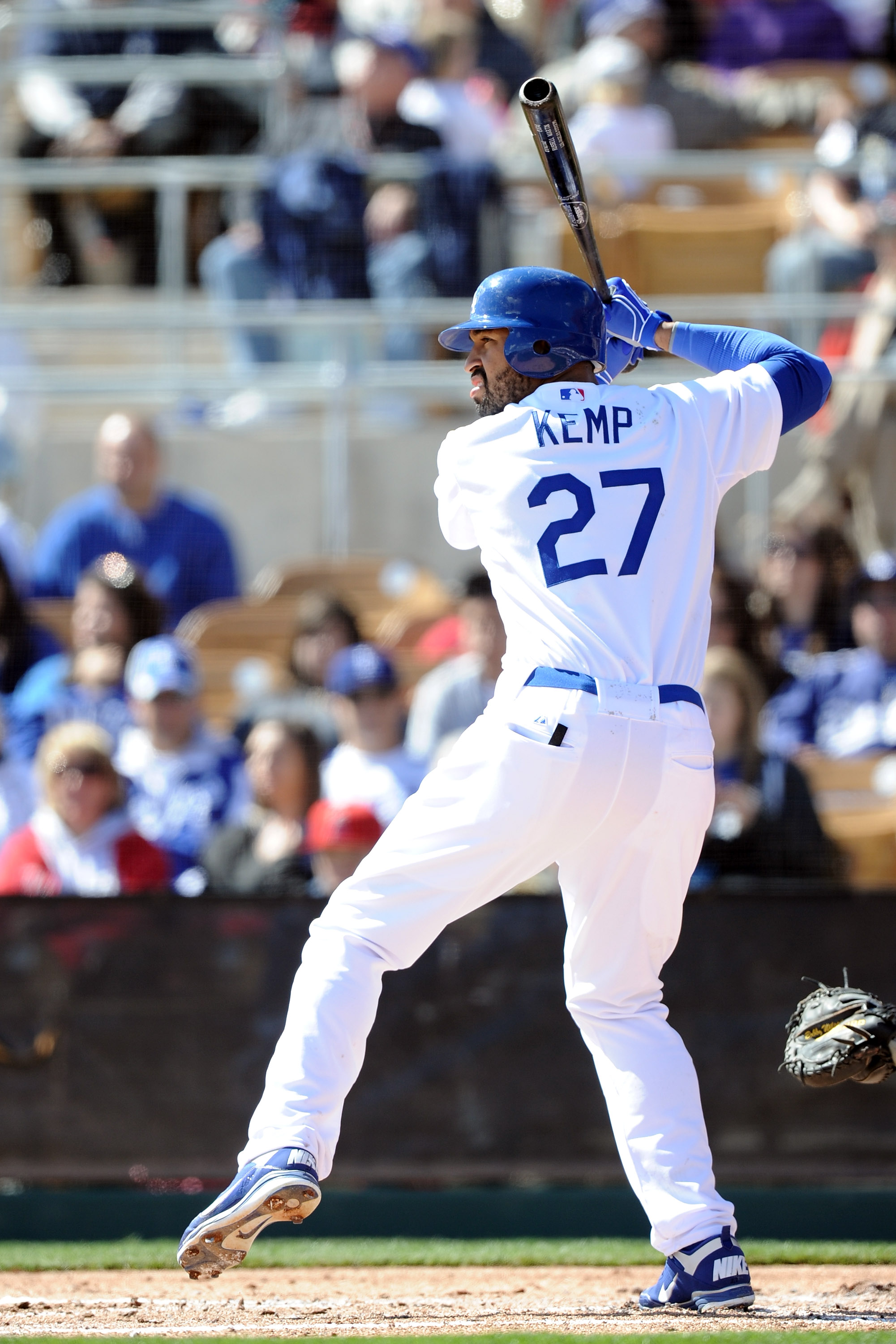 PHOENIX, AZ - FEBRUARY 27:  Matt Kemp #27 of the  Los Angeles Dodgers at bat during spring training at Camelback Ranch on February 27, 2011 in Phoenix, Arizona.  (Photo by Harry How/Getty Images)