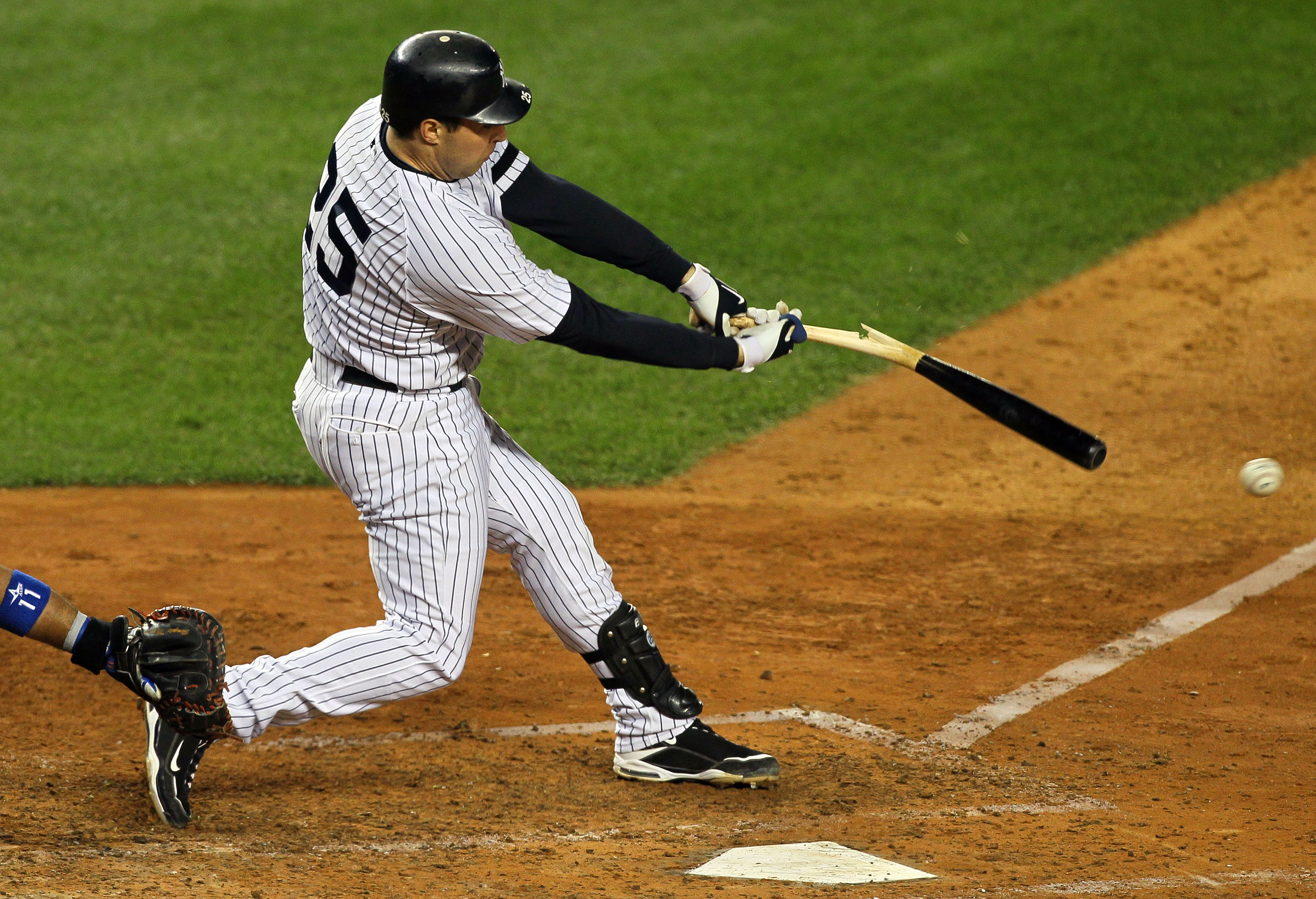 NEW YORK - OCTOBER 18:  Mark Teixeira #25 of the New York Yankees hits a broken bat ground out to the shortstop in the bottom of the sixth inning against the Texas Rangers in Game Three of the ALCS during the 2010 MLB Playoffs at Yankee Stadium on October