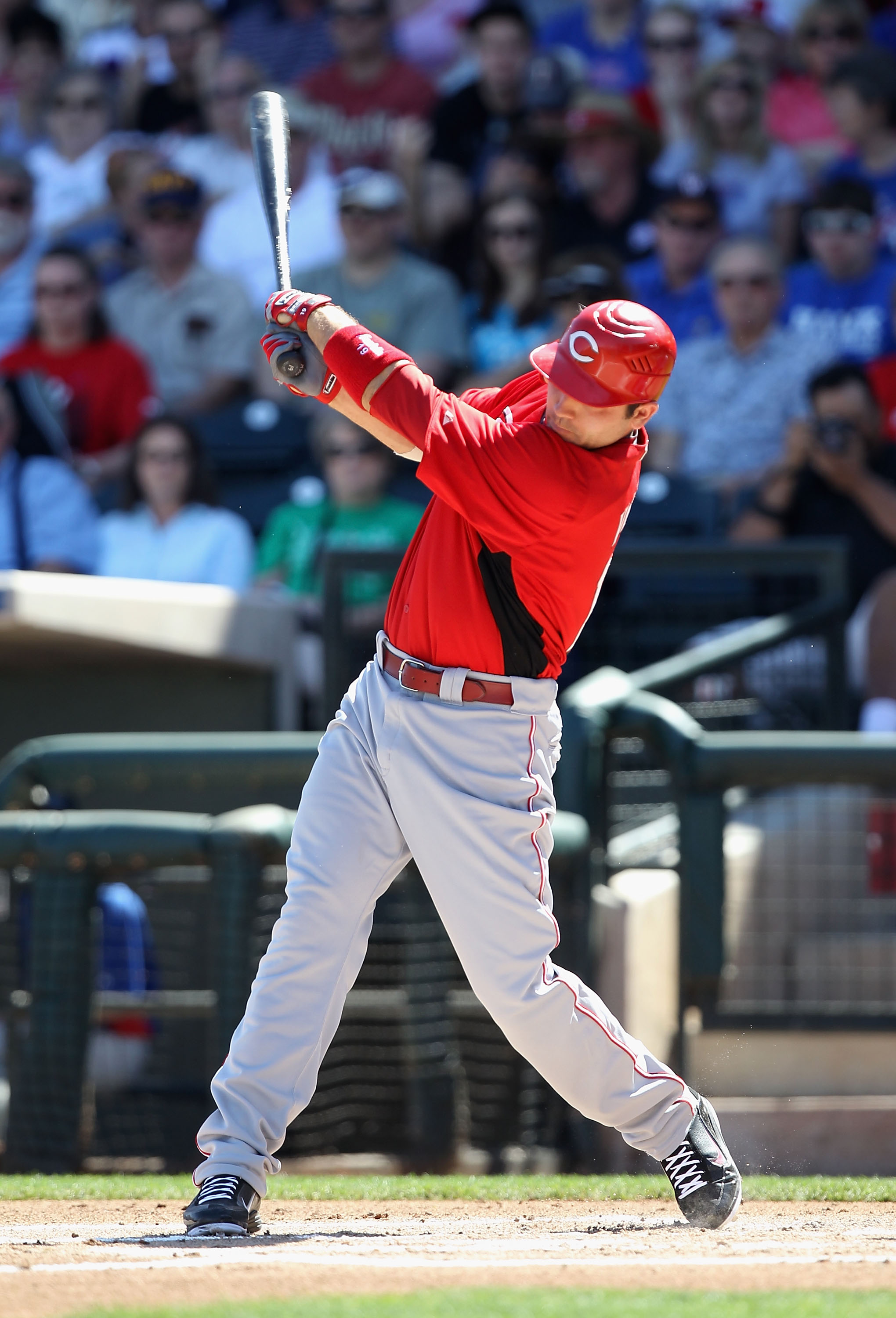 SURPRISE, AZ - MARCH 11:  Joey Votto #19 of the Cincinnati Reds hits a RBI single during the first inning of the spring training game against the Texas Rangers at Surprise Stadium on March 11, 2011 in Surprise, Arizona.  (Photo by Christian Petersen/Getty