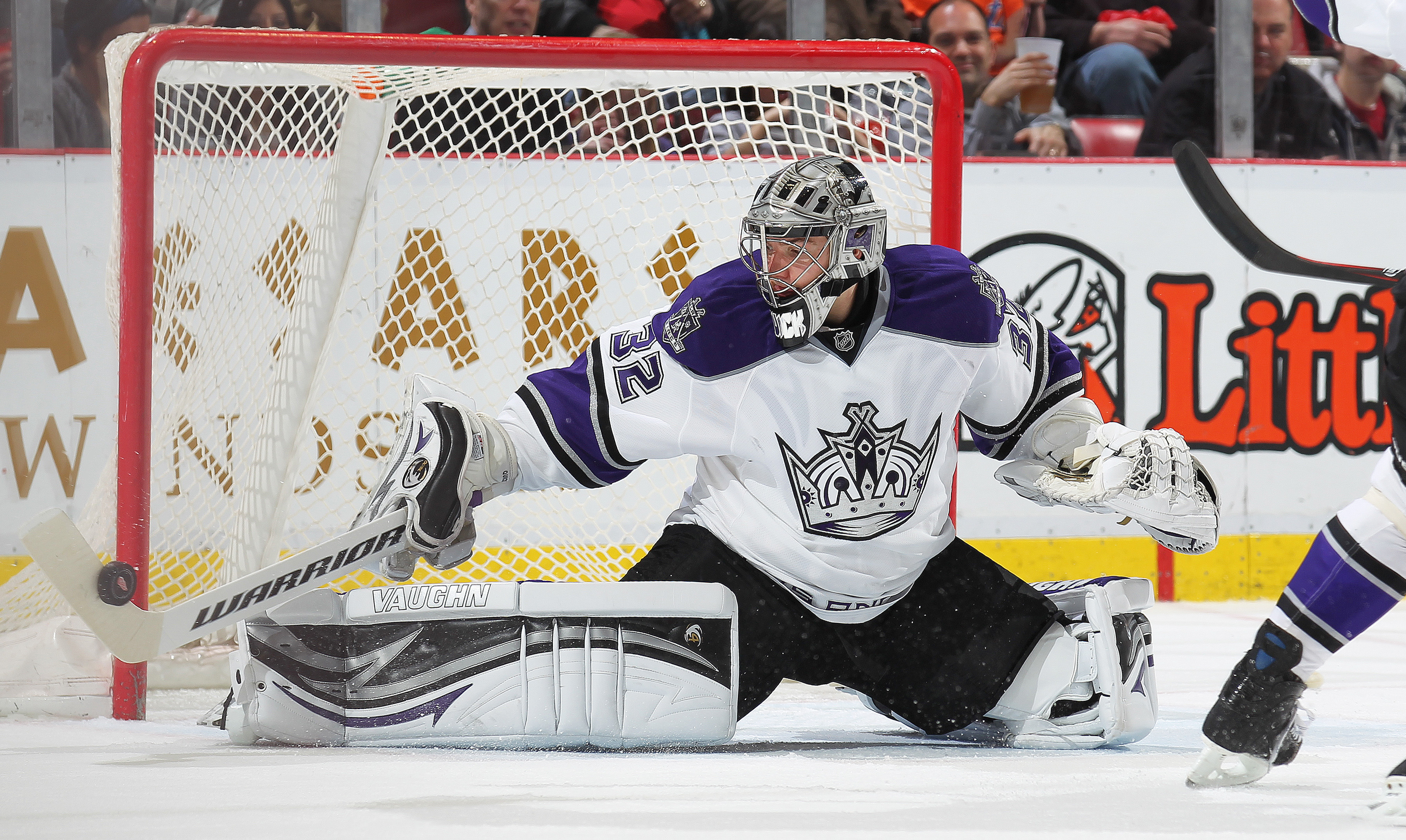 DETROIT, MI - MARCH 9:  Jonathan Quick #32 of the Los Angeles Kings gets his stick on a shot in a game against the Detroit Red Wings on March 9, 2011 at the Joe Louis Arena in Detroit, Michigan. The Kings defeated the Wings 2-1. (Photo by Claus Andersen/G