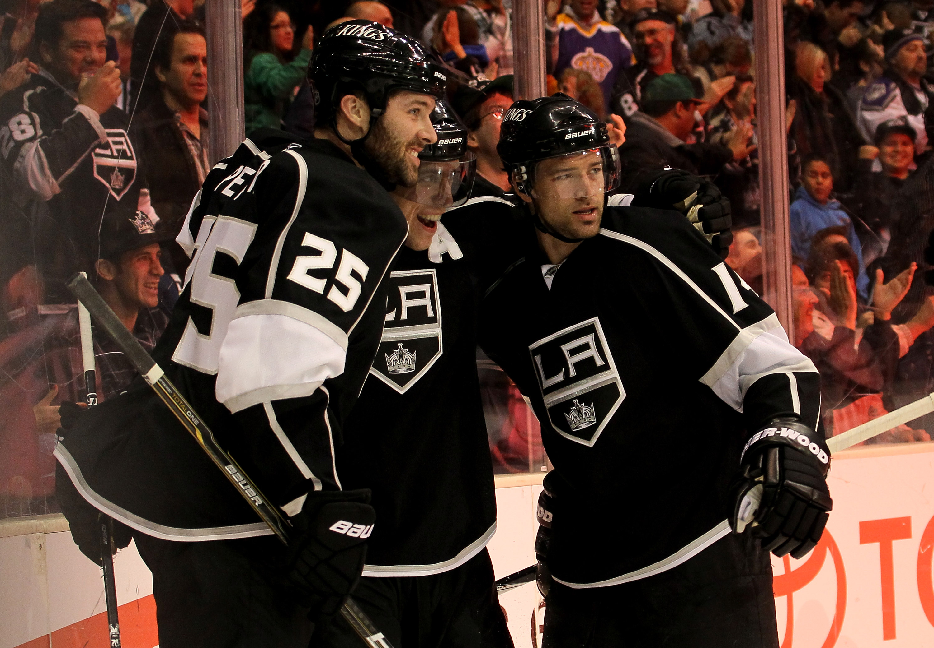 LOS ANGELES, CA - MARCH 7:  Justin Williams #14 (R) of the Los Angeles Kings celebrates with Anze Kopitar #11 (C) and Dustin Penner #25 after his second period goal against the Dallas Stars at Staples Center on March 7, 2011 in Los Angeles, California.