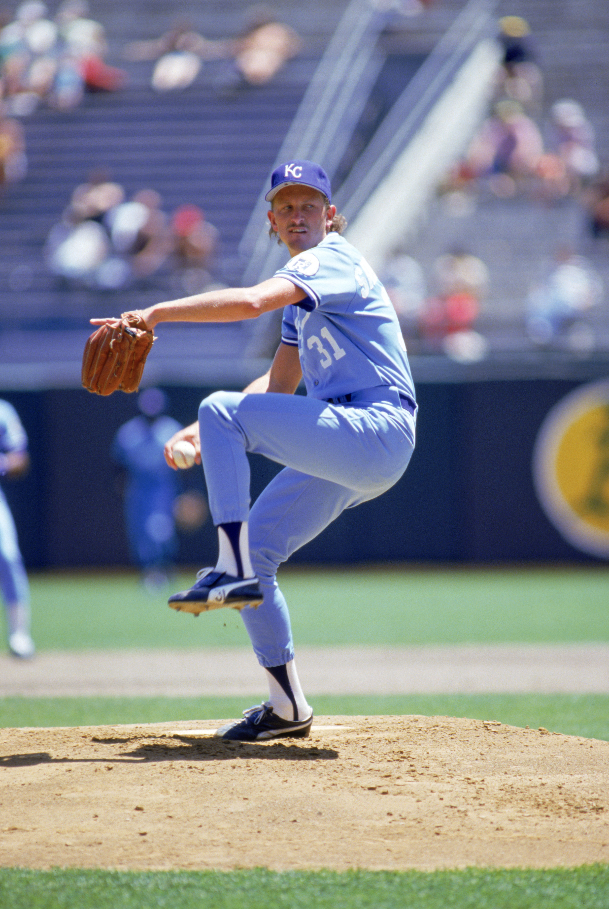OAKLAND, CA - 1986:  Bret Saberhagen #31 of the Kansas City Royals winds up for a pitch during a game against the Oakland Athletics at Oakland-Alameda County Coliseum in 1986 in Oakland, California.  (Photo by Otto Greule Jr/Getty Images)