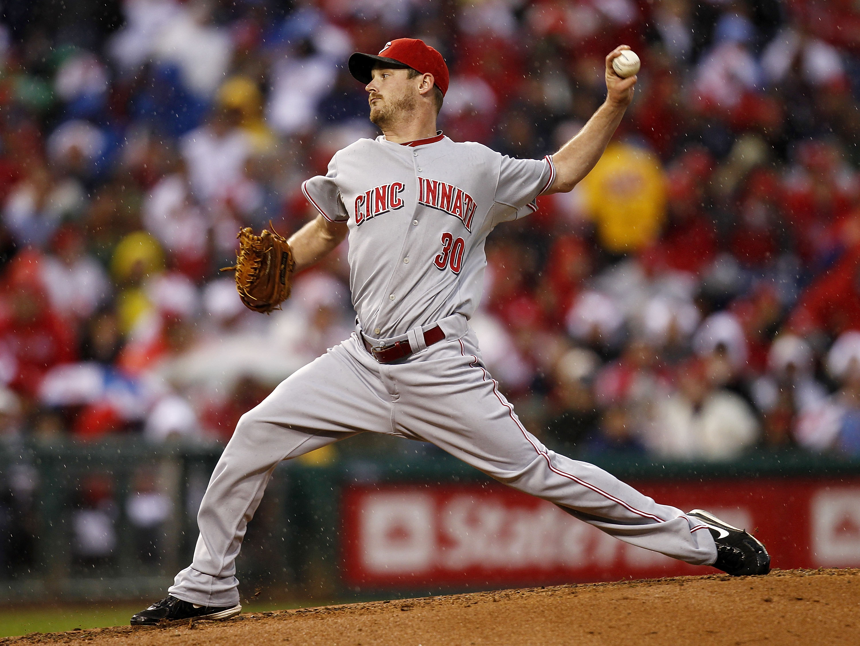 PHILADELPHIA - OCTOBER 06:  Travis Wood #30 of the Cincinnati Reds delivers in Game 1 of the NLDS against the Philadelphia Phillies at Citizens Bank Park on October 6, 2010 in Philadelphia, Pennsylvania.  (Photo by Jeff Zelevansky/Getty Images)