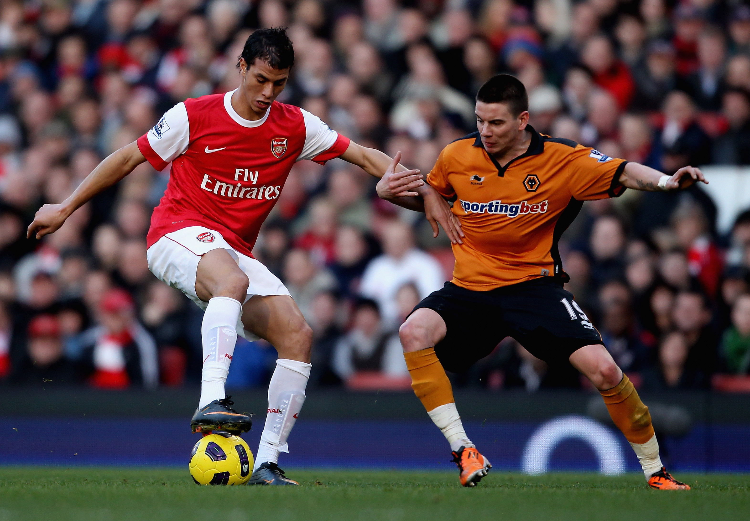 LONDON, ENGLAND - FEBRUARY 12:  Adam Hammill of Wolves (R) in action with Marouane Chamakh of Arsenal during the Barclays Premier League match between Arsenal and Wolverhampton Wanderers on February 12, 2011 in London, England.  (Photo by Scott Heavey/Get