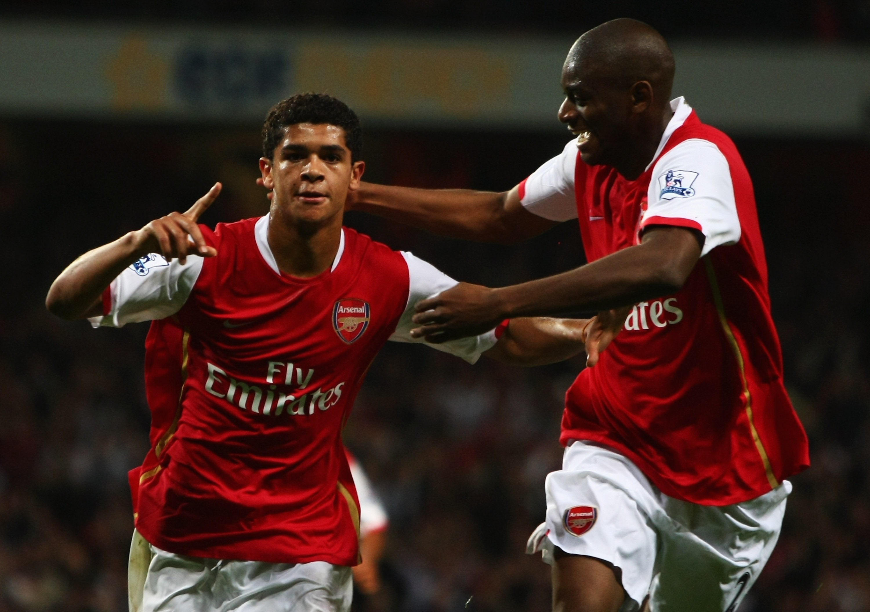 LONDON - SEPTEMBER 25:  Denilson of Arsenal celebrates with Abou Diaby as he scores their second goal during the Carling Cup Third Round match between Arsenal and Newcastle United at the Emirates Stadium on September 25, 2007 in London, England.  (Photo b