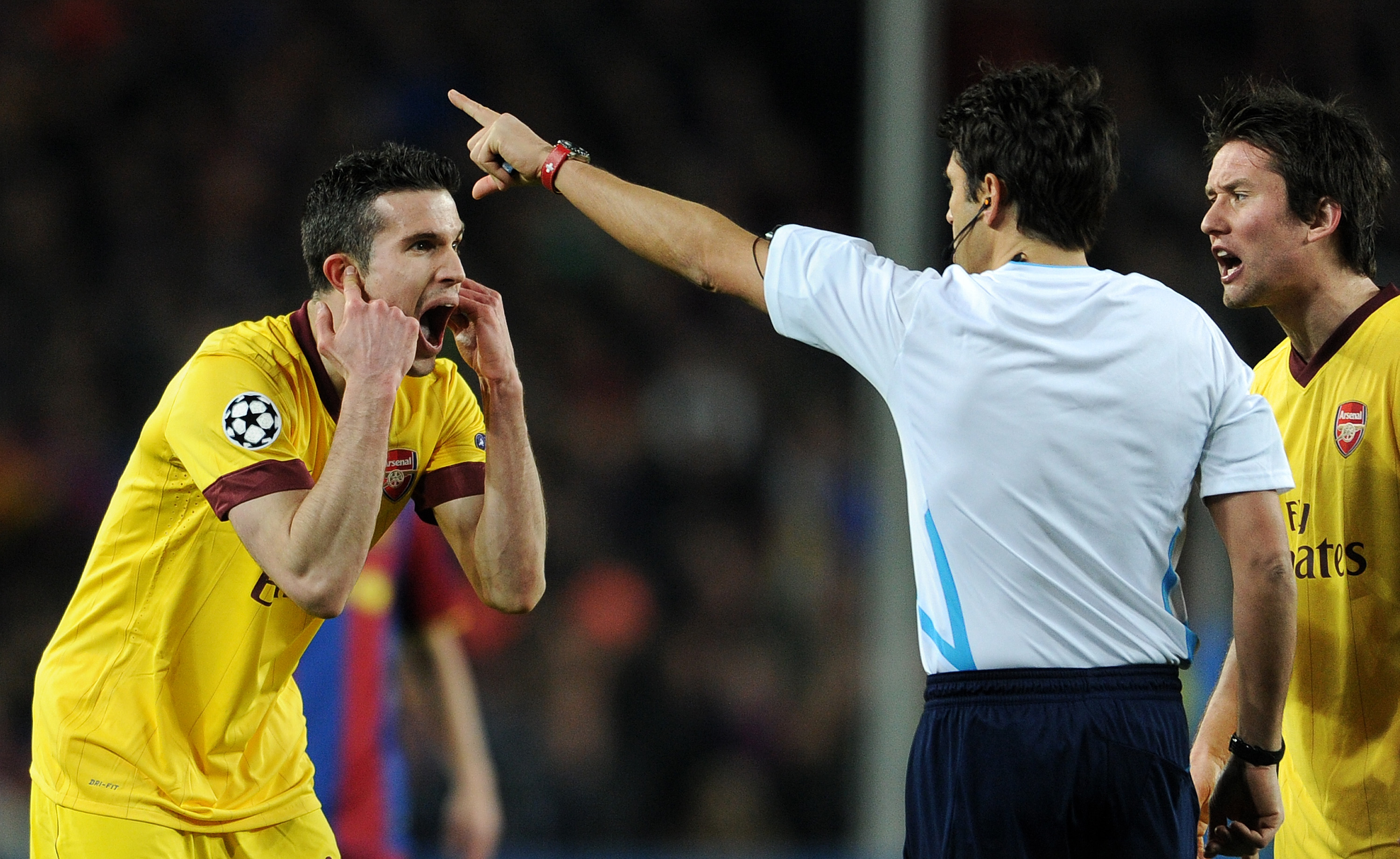 BARCELONA, SPAIN - MARCH 08:  Robin van Persie (L) of Arsenal reacts to referee Massimo Busacca after receiving a red card during the UEFA Champions League round of 16 second leg match between Barcelona and Arsenal on March 8, 2011 in Barcelona, Spain.  (