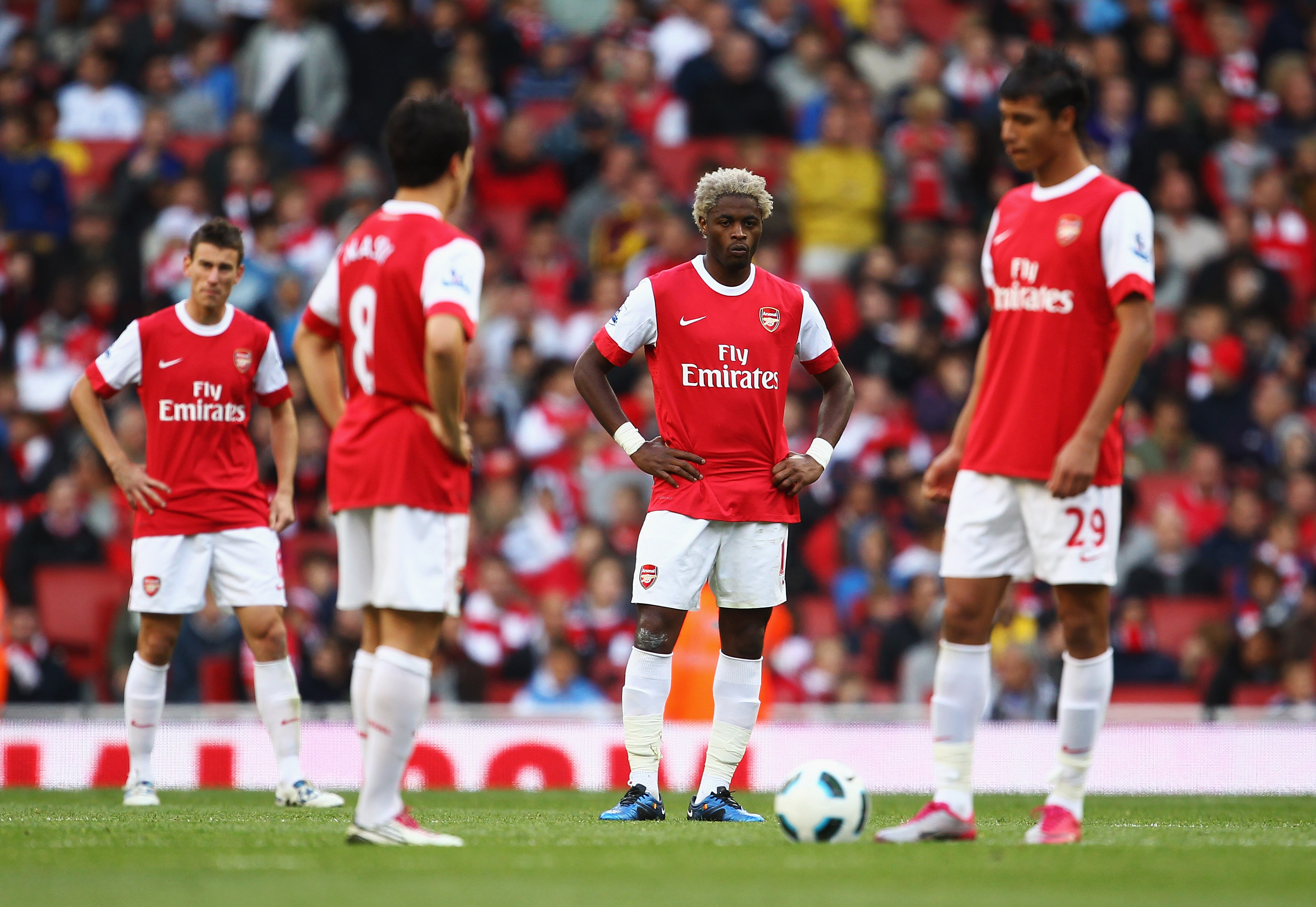 LONDON, ENGLAND - SEPTEMBER 25:  (L-R) Laurent Koscielny, Samir Nasri, Alex Song and Marouane Chamakh of Arsenal look dejected as Peter Odemwingie of West Bromwich Albion scores their first goal during the Barclays Premier League match between Arsenal and