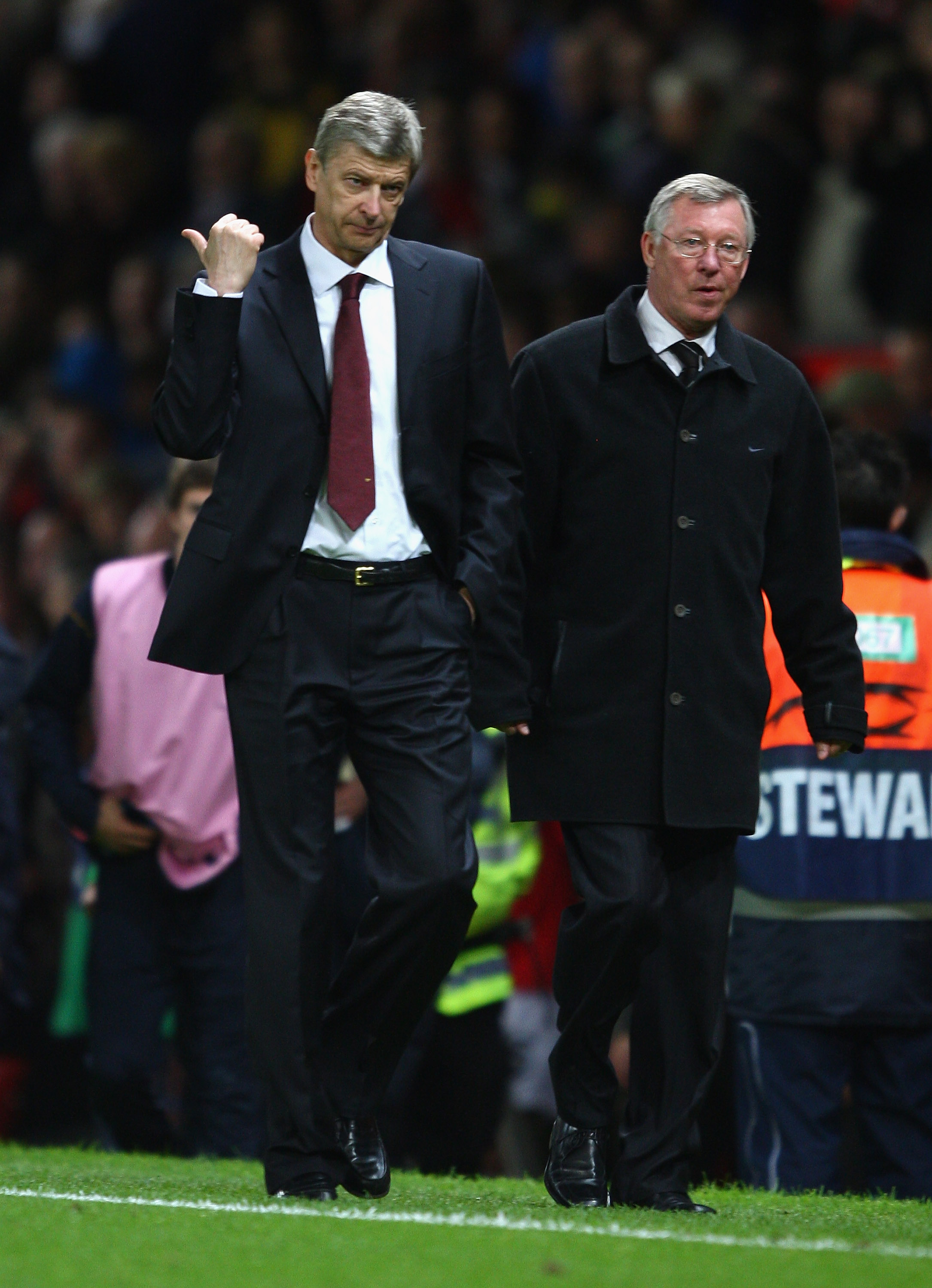 MANCHESTER, UNITED KINGDOM - APRIL 29:   Arsenal Manager Arsene Wenger gestures as he walks off with Manchester United Manager Sir Alex Ferguson at the end of the UEFA Champions League Semi Final First Leg match between Manchester United and Arsenal at Ol