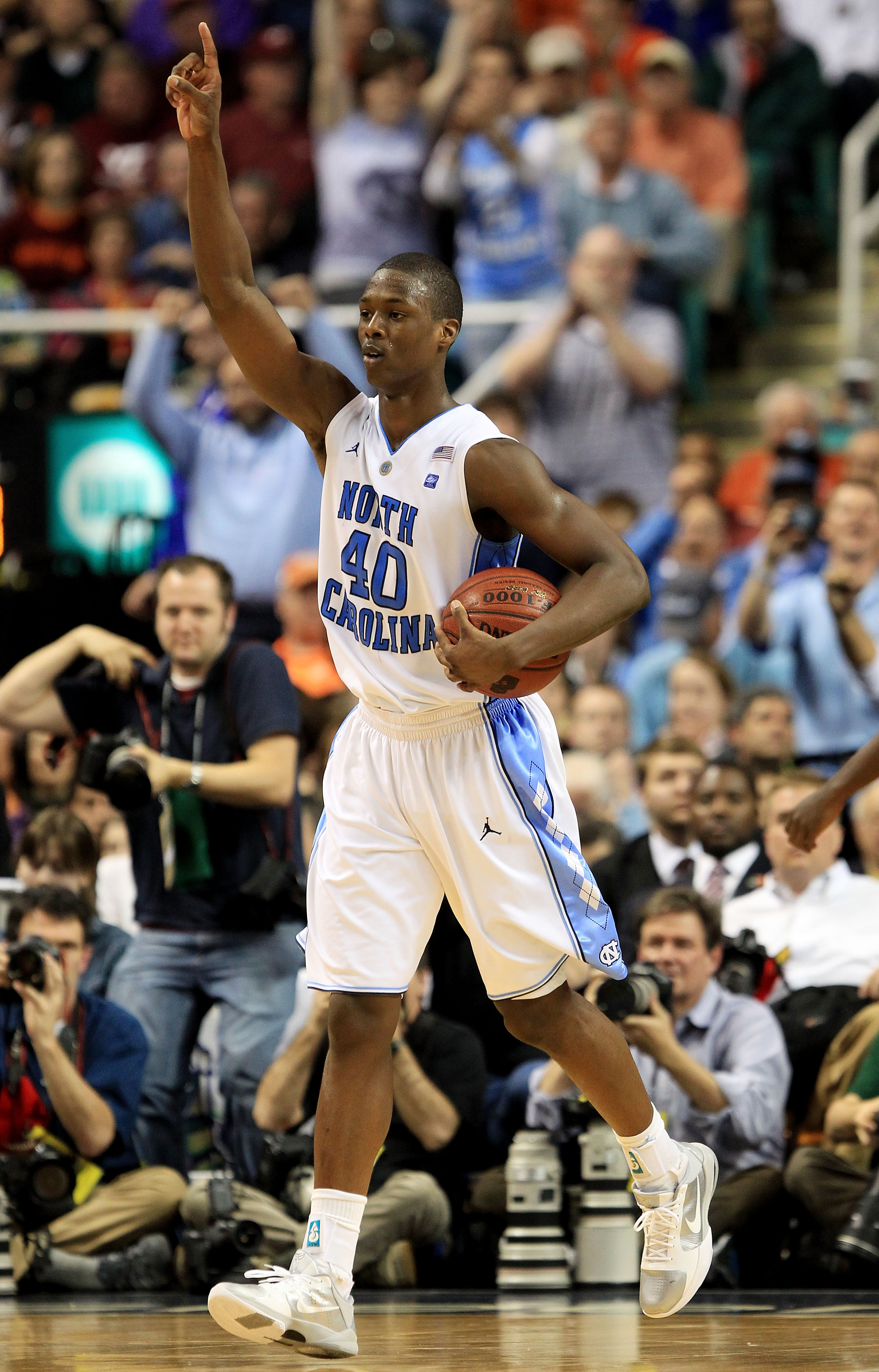 GREENSBORO, NC - MARCH 12:  Harrison Barnes #40 of the North Carolina Tar Heels celebrates their 92-87 win over the Clemson Tigers during overtime in the semifinals of the 2011 ACC men's basketball tournament at the Greensboro Coliseum on March 12, 2011 i