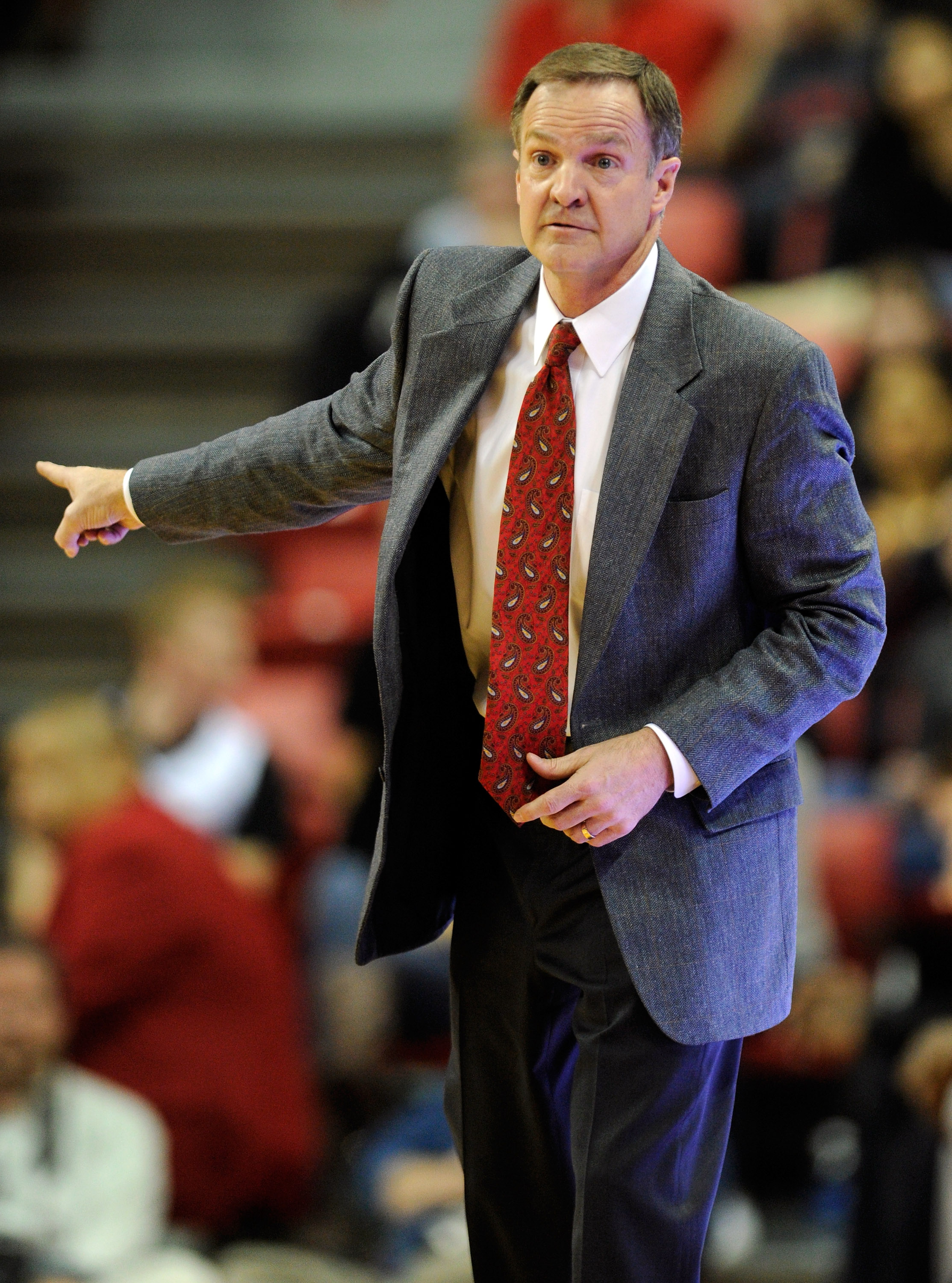 LAS VEGAS, NV - FEBRUARY 15:  Head coach Lon Kruger of the UNLV Rebels gestures during a game against the Air Force Falcons at the Thomas & Mack Center February 15, 2011 in Las Vegas, Nevada. UNLV won 49-42.  (Photo by Ethan Miller/Getty Images)