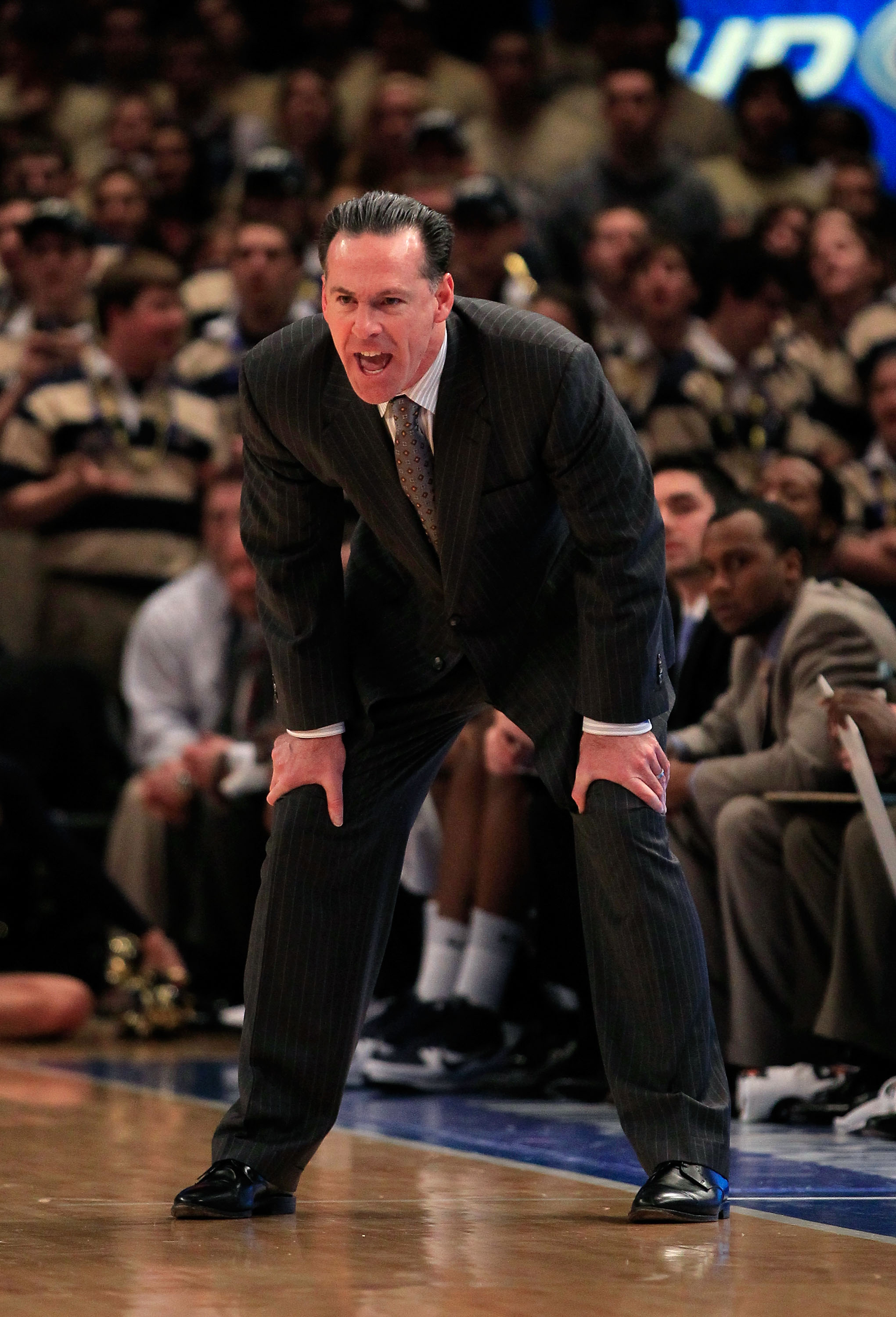 NEW YORK, NY - MARCH 10: head coach Jamie Dixon of the Pittsburgh Panthers looks on from the bench against the Connecticut Huskies during the quarterfinals of the 2011 Big East Men's Basketball Tournament presented by American Eagle Outfitters  at Madison