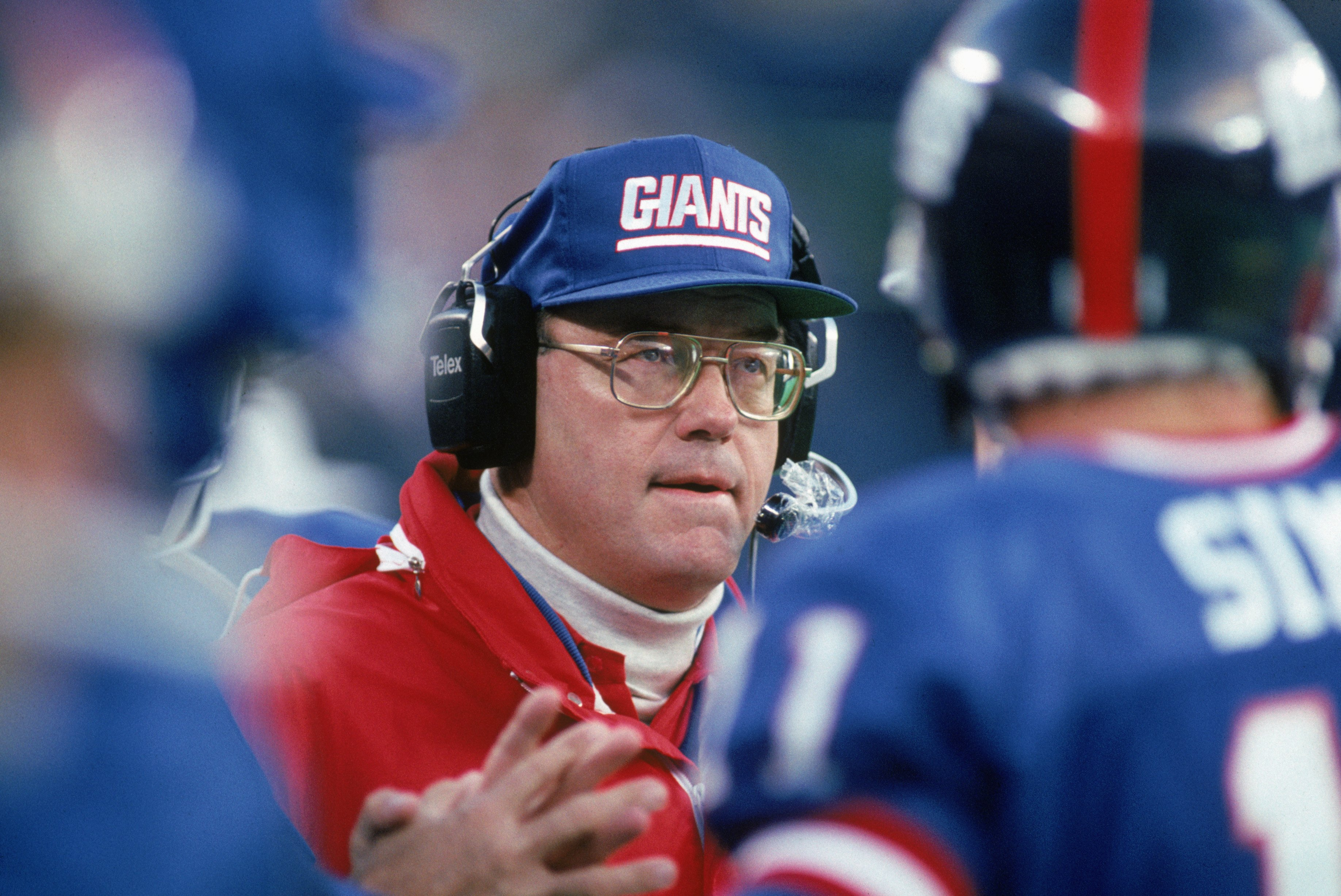 EAST RUTHERFORD, NJ - OCTOBER 28:  Running back coach Ray Handley of the New York Giants looks on during a game against the Washington Redskins at Giants Stadium October 28, 1990 in East Rutherford, New Jersey.  The Giants won 21-10.  (Photo by George Ros